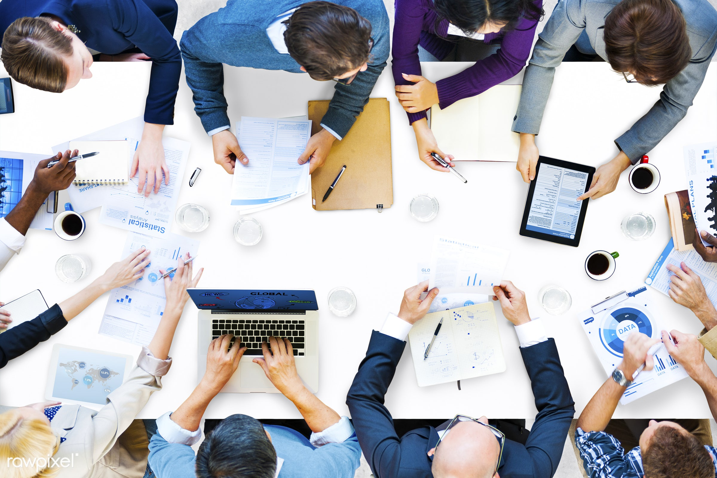 Group of diverse people having a business meeting - aerial, analysis, data, device, digital, discussion, group, information...