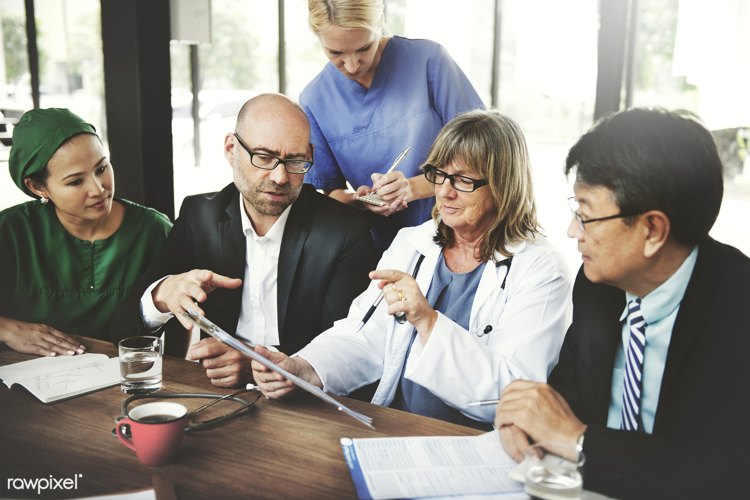 Group of medical people having a meeting - advice, analysis, boardroom, brainstorming, colleagues, communication, conference...