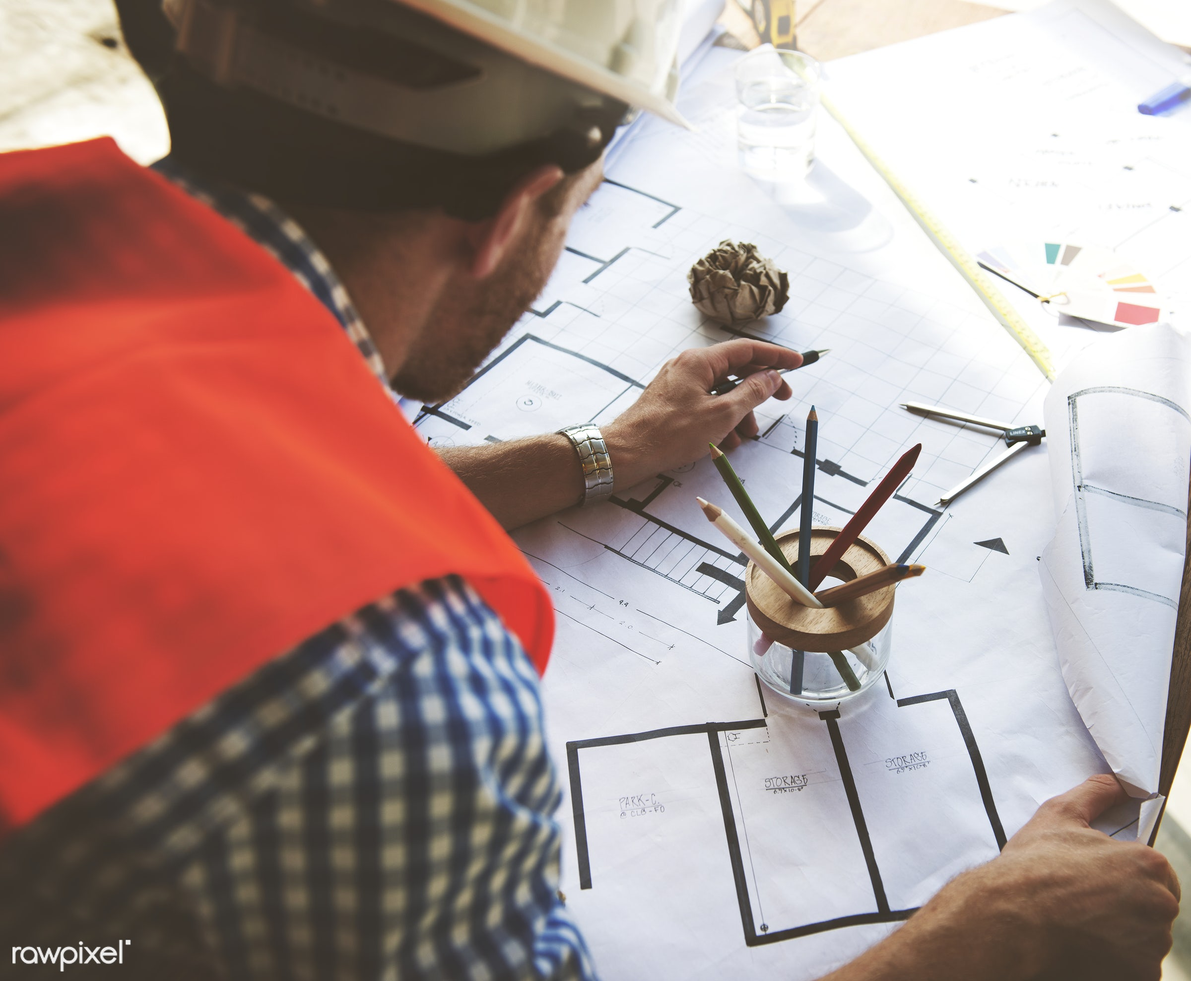 Site construction engineering is working on a building plan - architect, architecture, blue print, board, construction,...