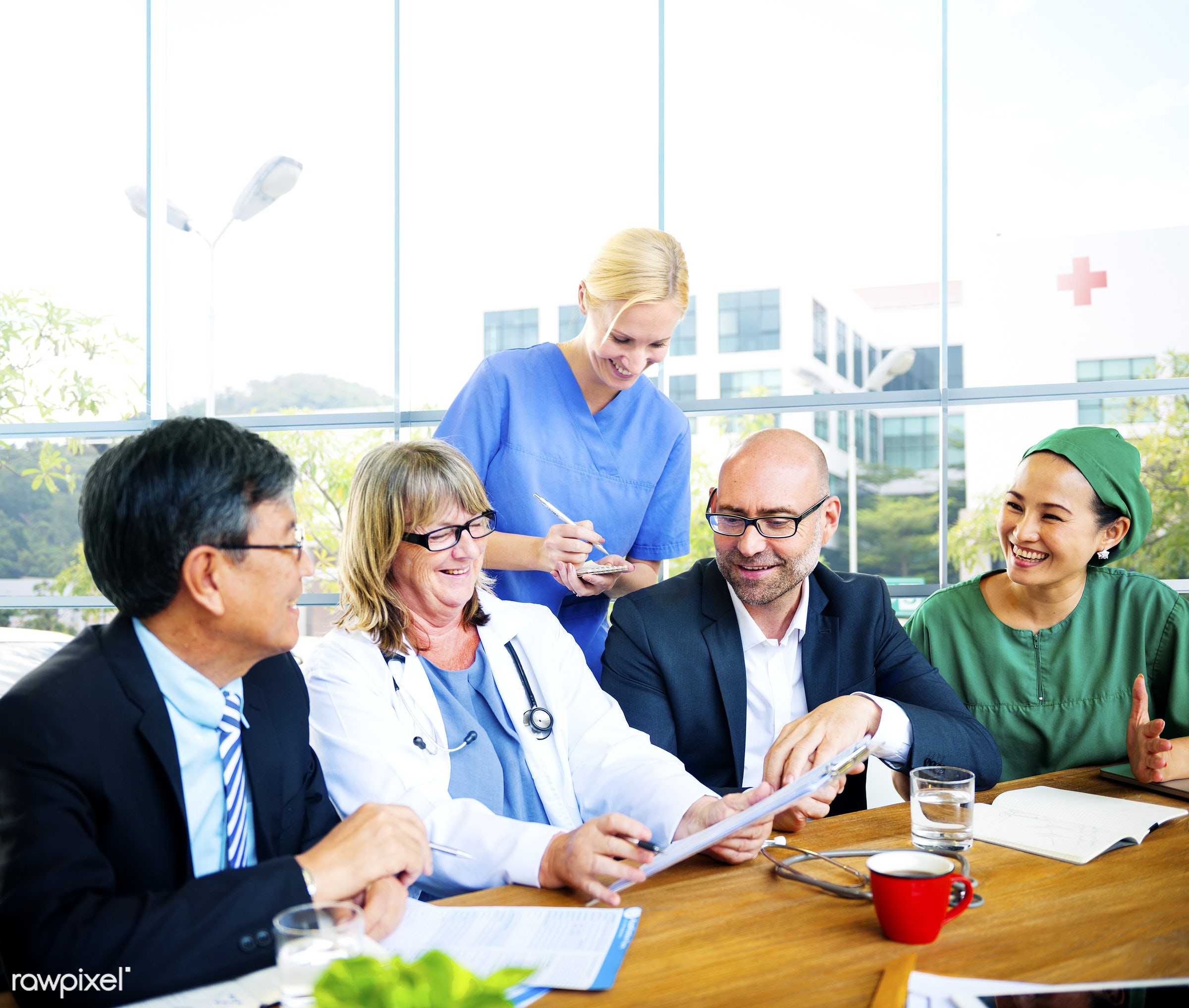 Group of medical people having a meeting - asian, caucasian, colleagues, diverse, doctor, group, healthcare, medical, nurses...