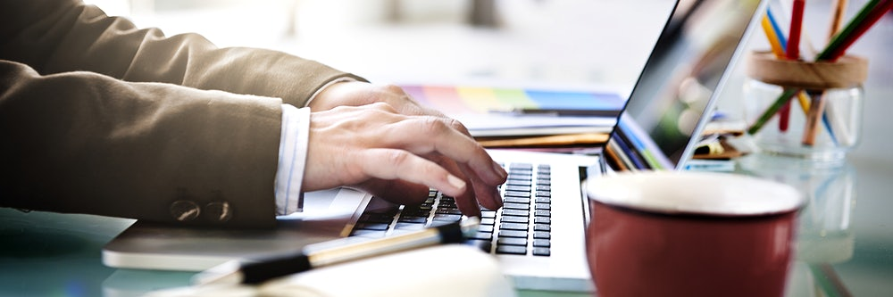 Businessman Working Typing Using Notebook Concept