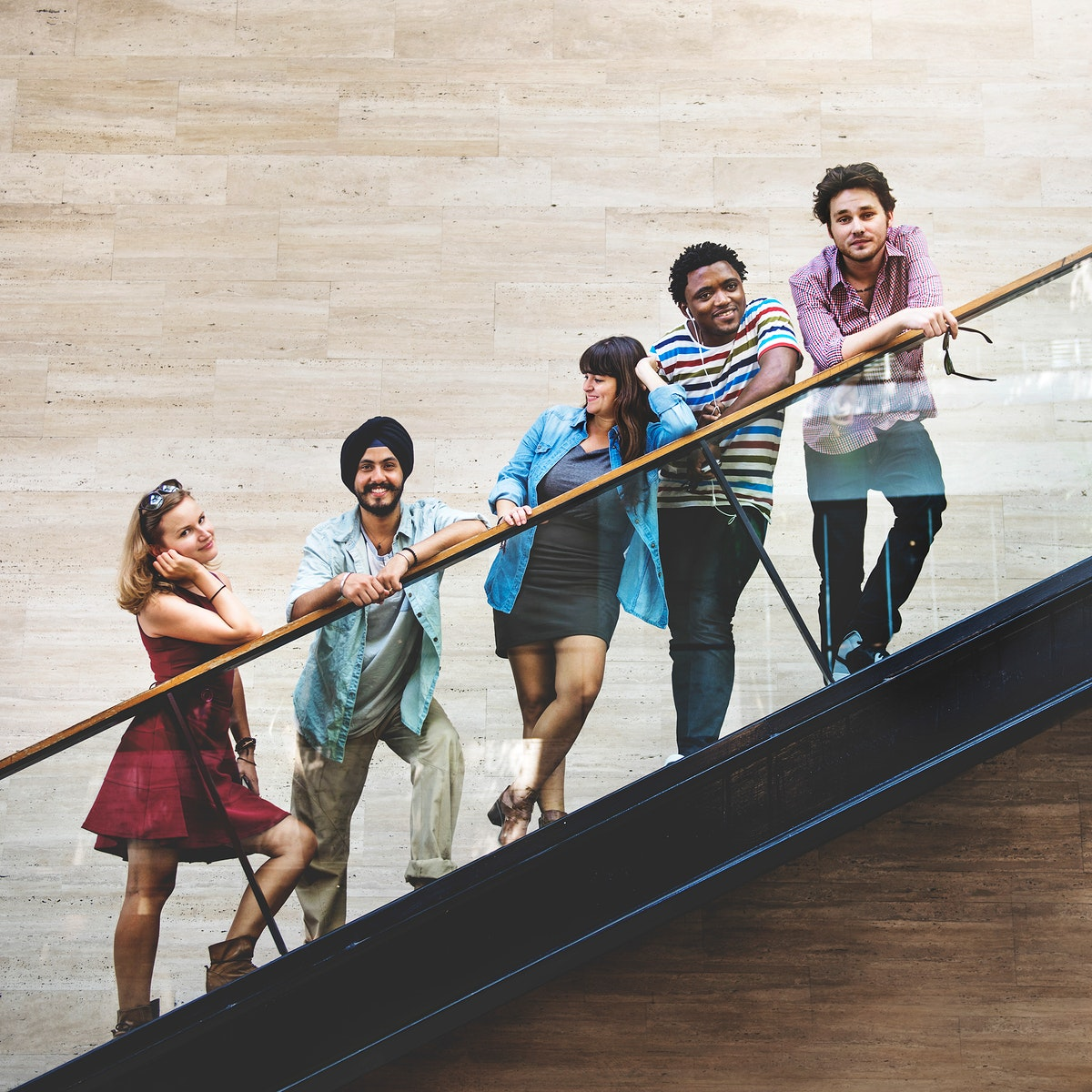 Group of diversity friends standing at staircase
