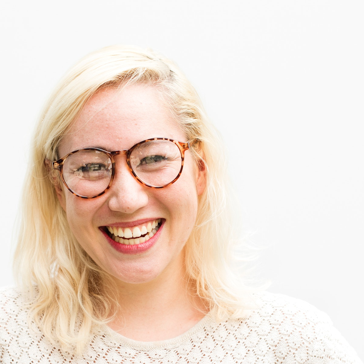 Blonde woman with a bright smile portrait