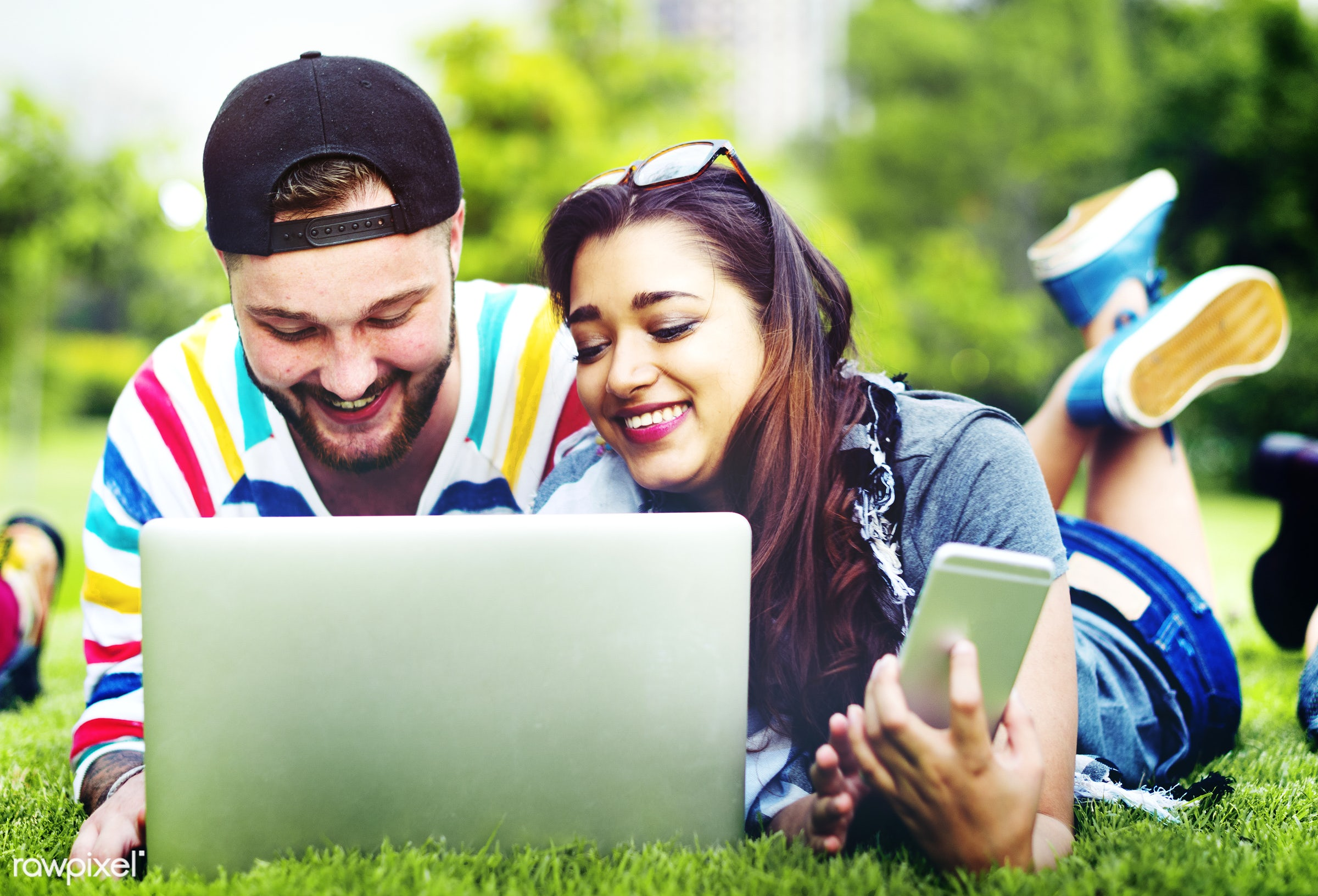 park, grass, pair, indian, two, friends, lying down, casual, outdoors, laptop, couple, devices, cheerful, smiling