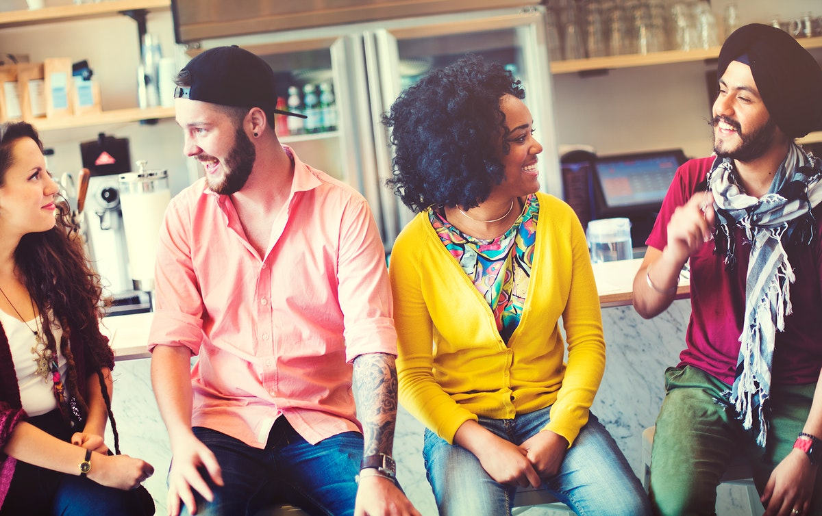 Group of friends sitting and disucussion cheerful at coffee shop