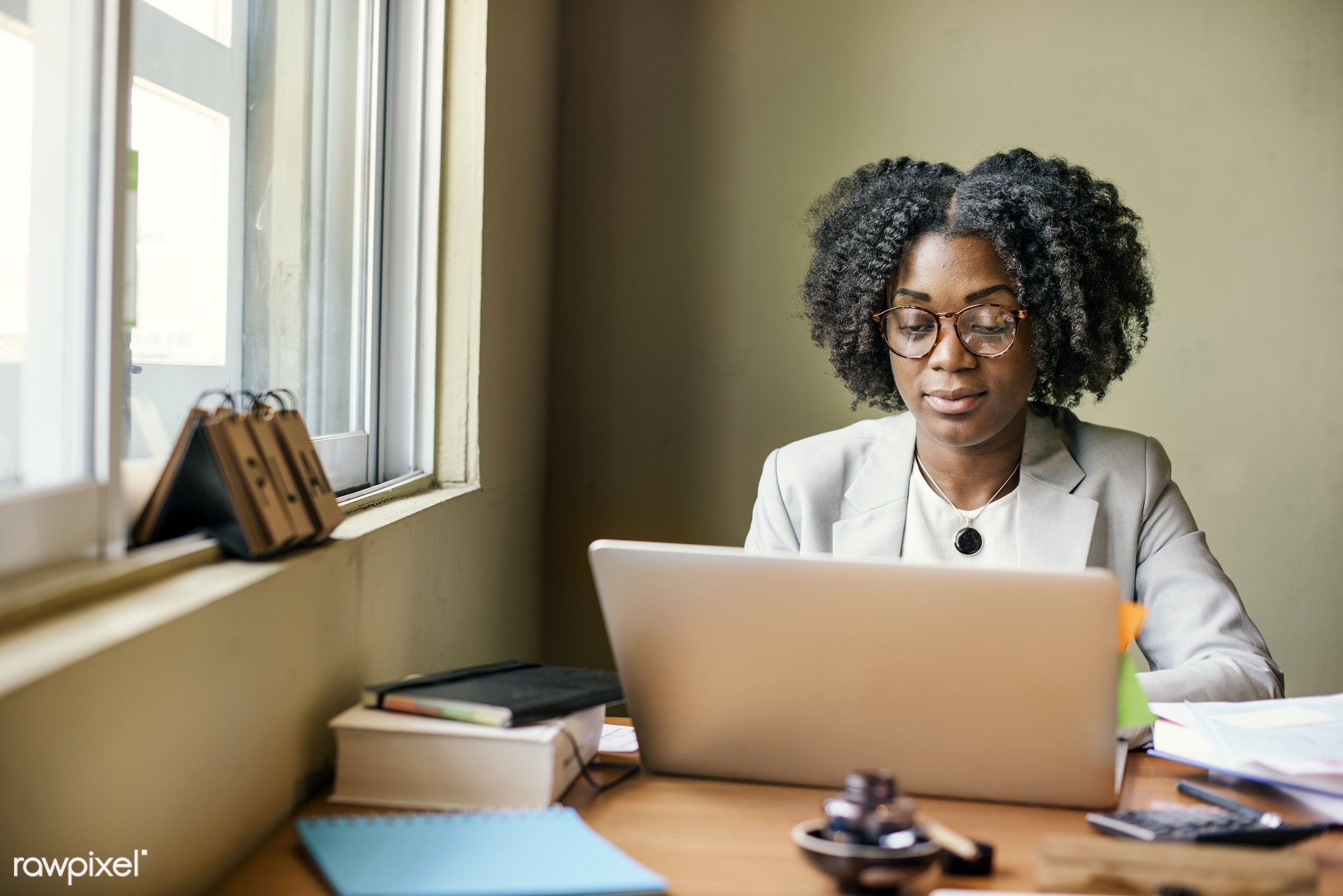Diverse pair of friends / colleagues shoot - businesswoman, laptop, african, african descent, analysing, browsing,...