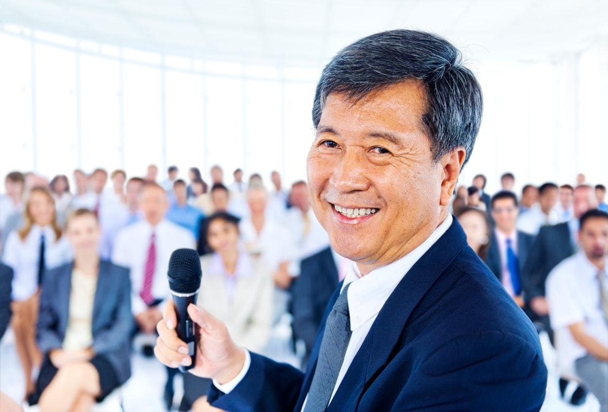 Senior man presenting at a conference