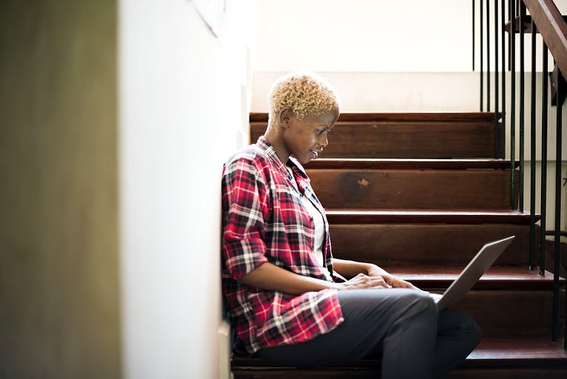 African woman working on a laptop