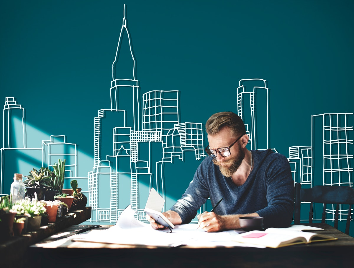 Caucasian man working with building illustration on green background