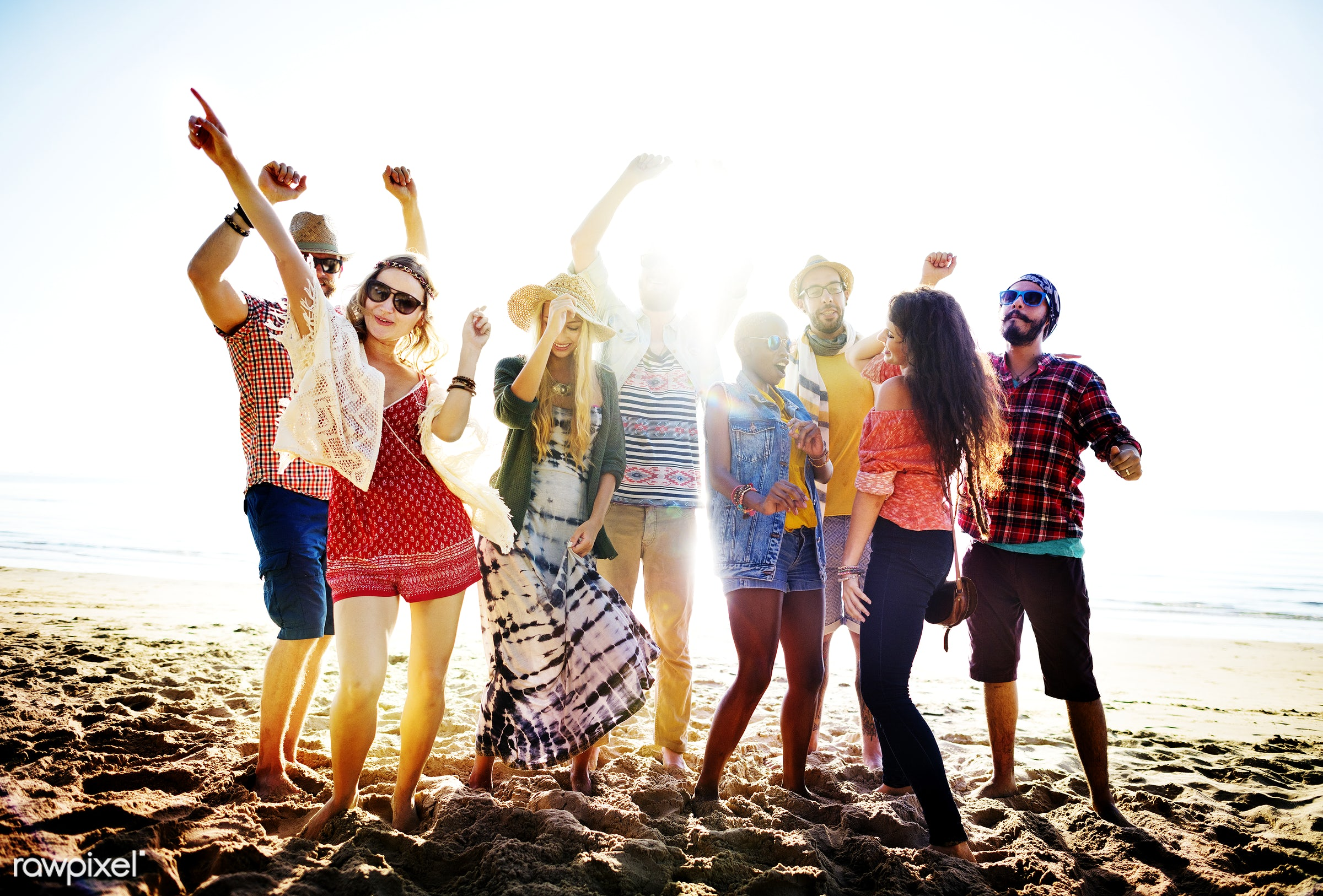 Friends having fun at the beach - action, activity, adult, african descent, arms raised, beach, beach party, casual,...