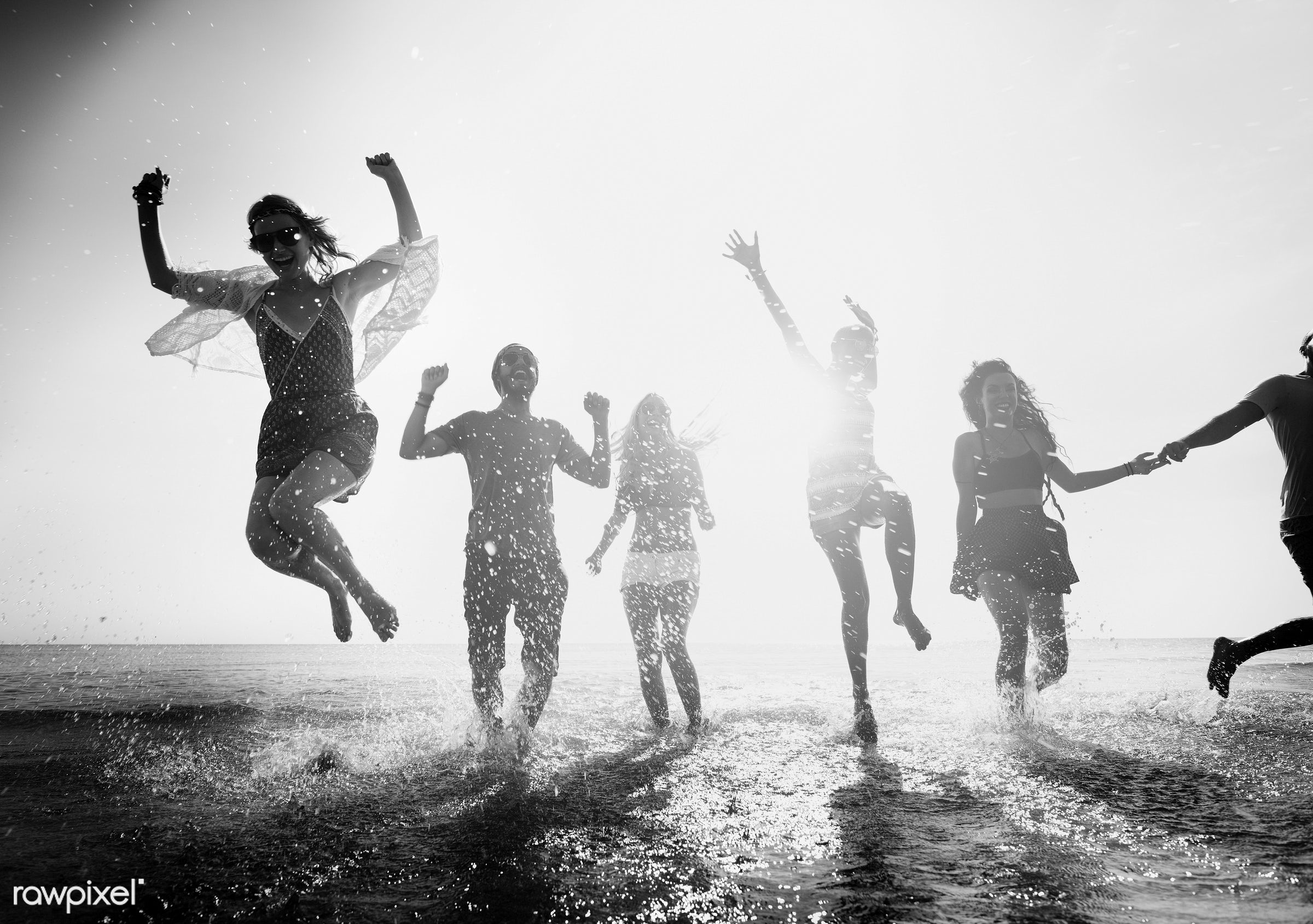 action, african descent, arms raised, backlit, beach, blurred, bonding, celebration, cheerful, chilling, dusk, ecstatic,...