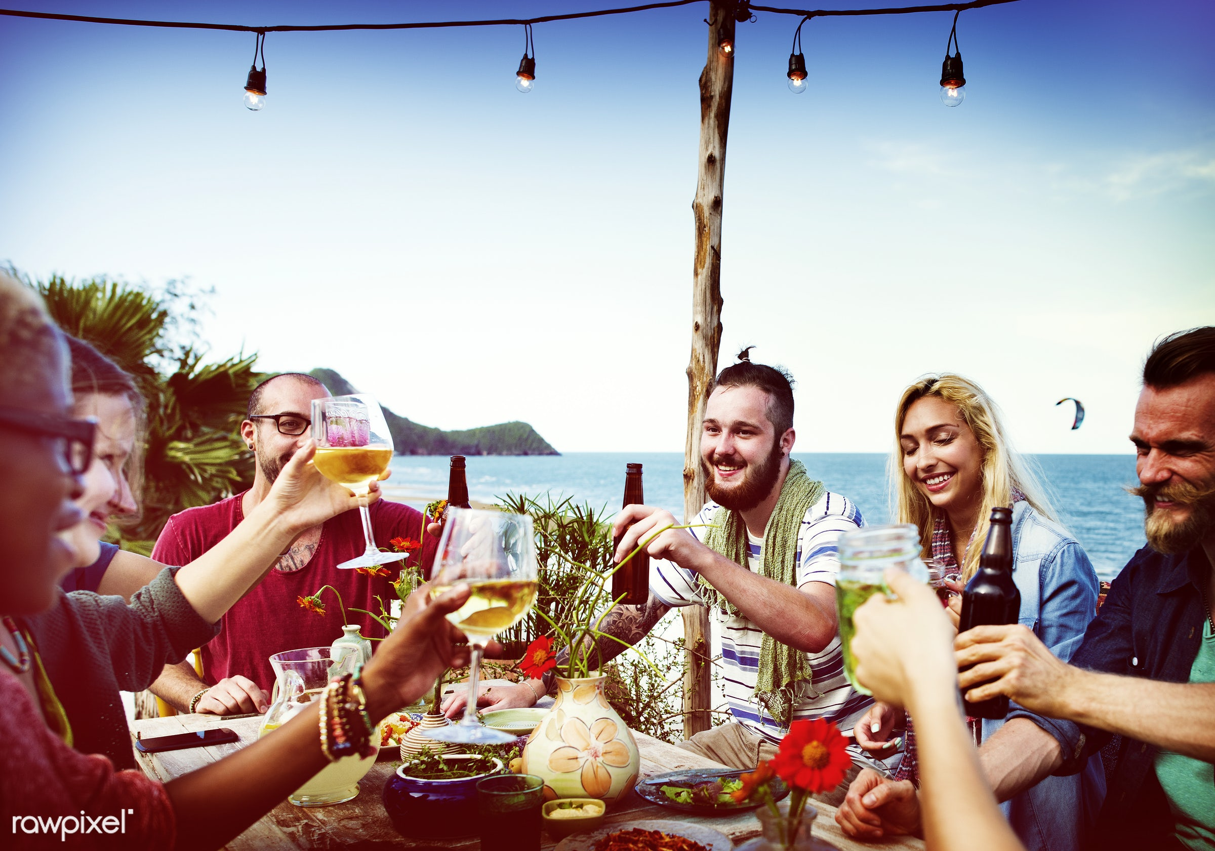Friends having a summer party - beer, dinner, picnic, active, beach, beverage, bonding, casual, celebration, cheerful,...