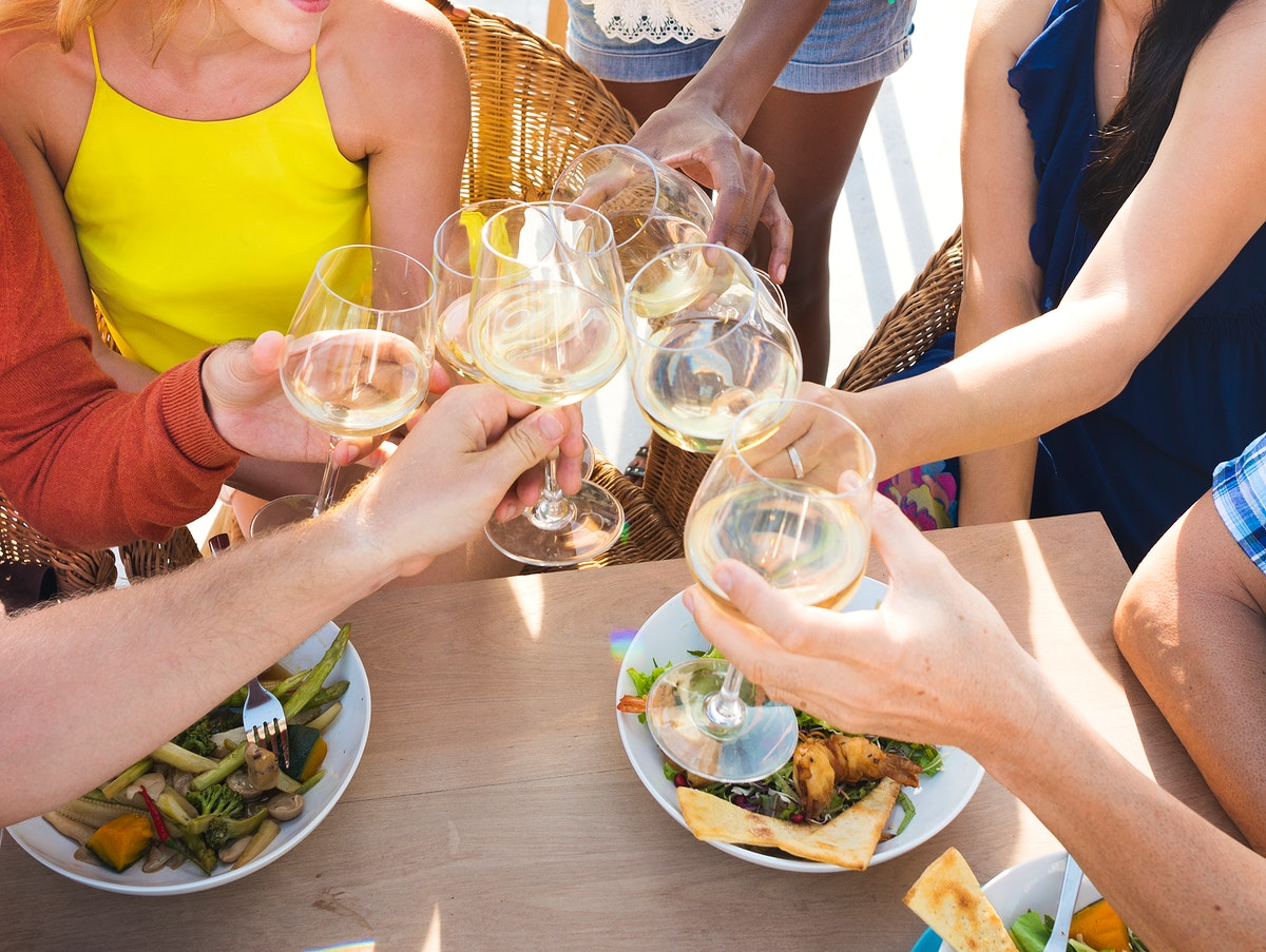 Group of friends drinking white wine