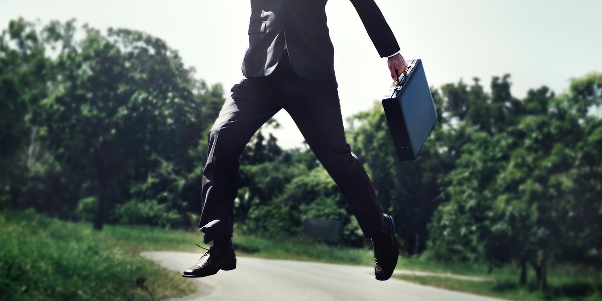 Businessman jump up in the park