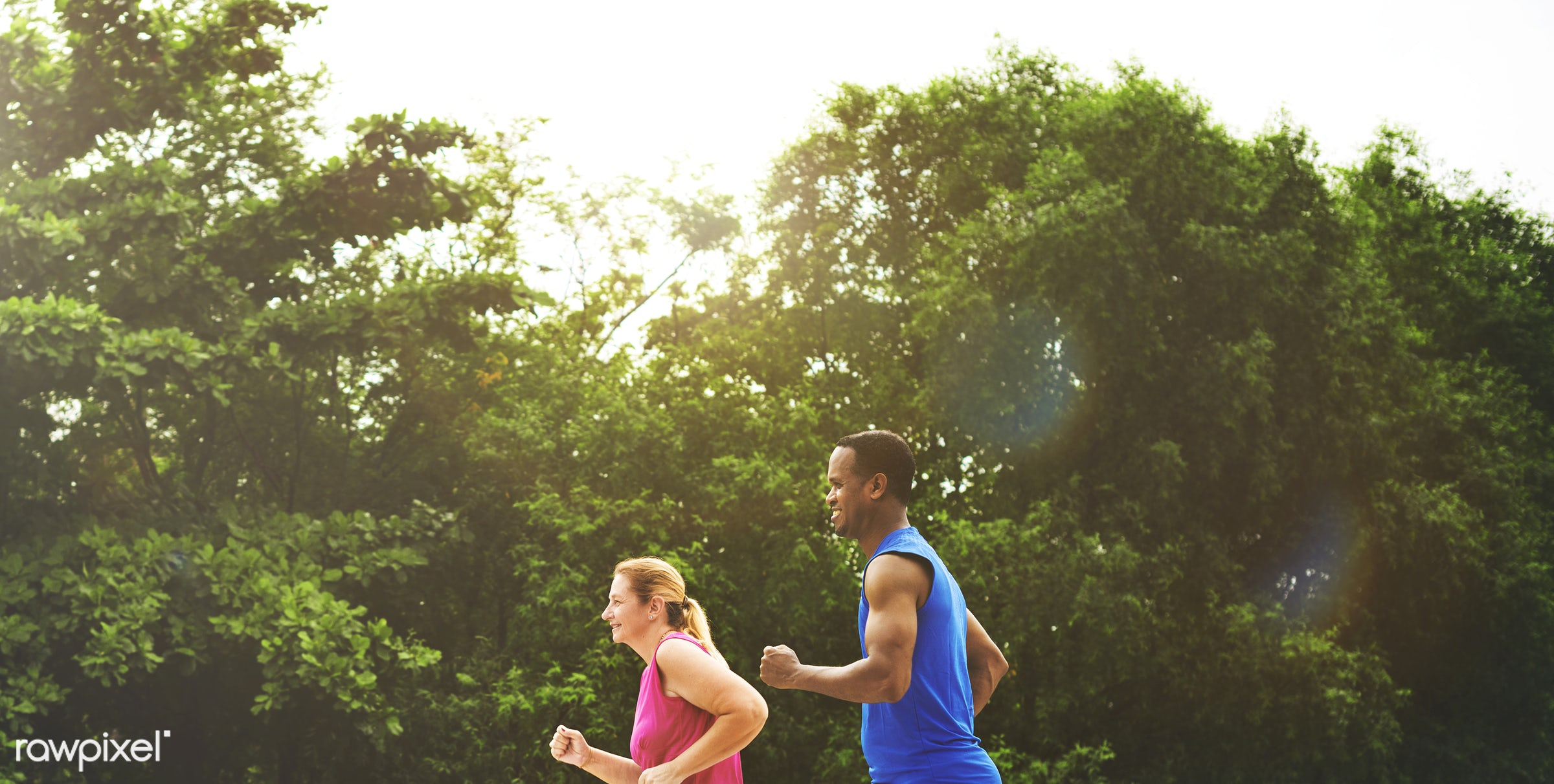 Mixed race couple exercising together in the park - sport, workout, exercise, radio, active, activity, app, application,...