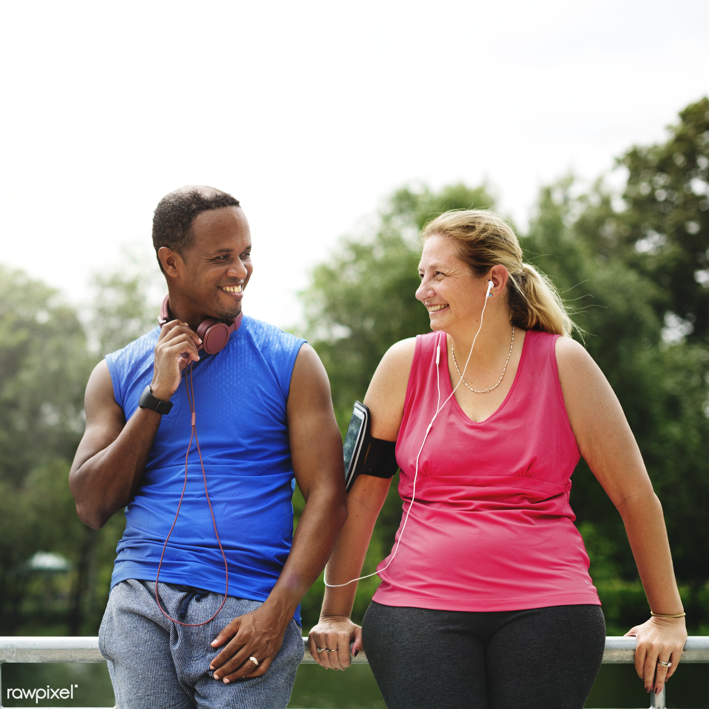 Mixed race couple exercising together in the park - african, african descent, bonding, cheerful, chubby, clothing, couple,...