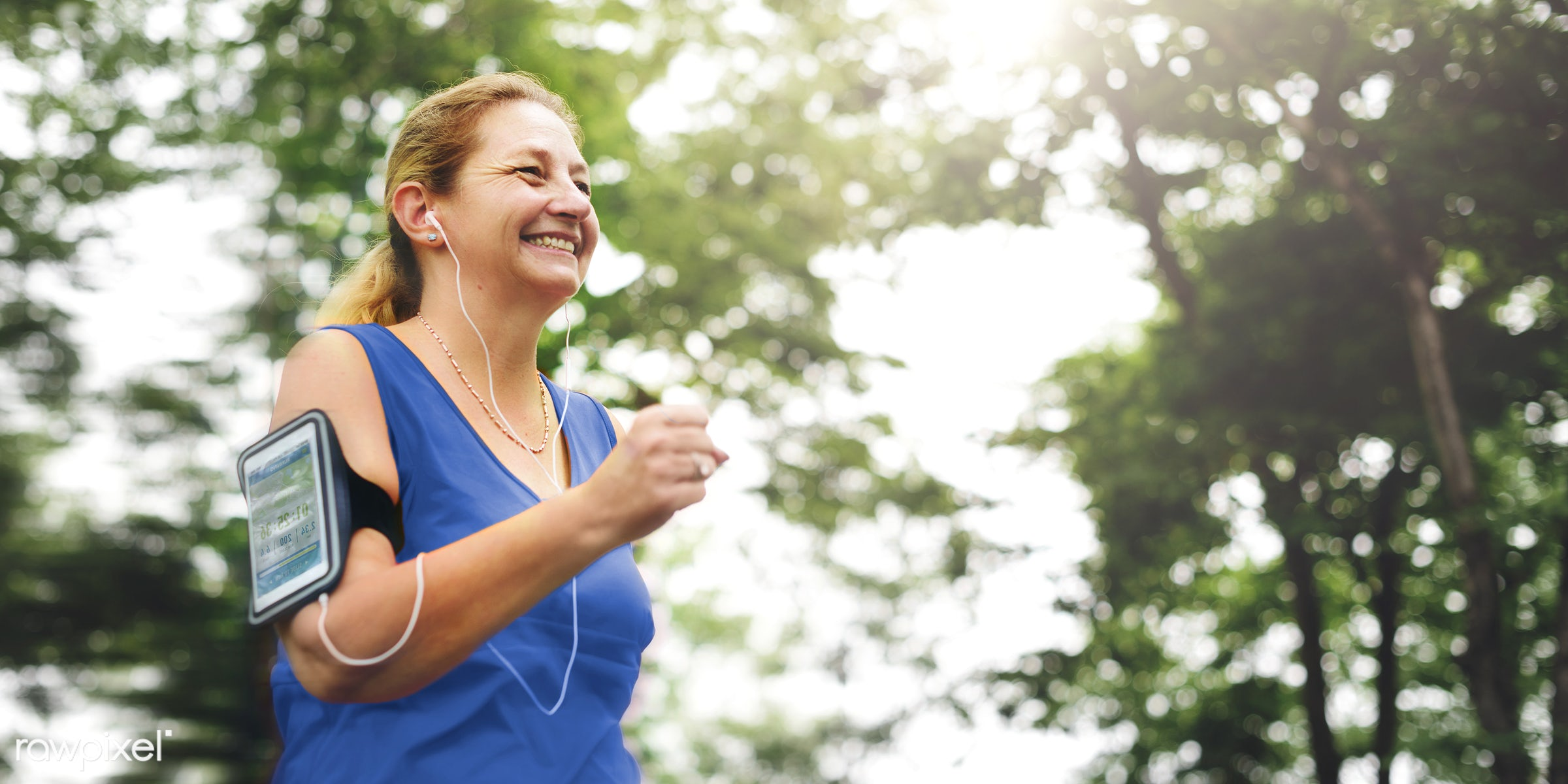 Mature woman jogging in the park - jogging, smiling, activity, cheerful, enjoyment, exercise, exercising, field, freshness,...