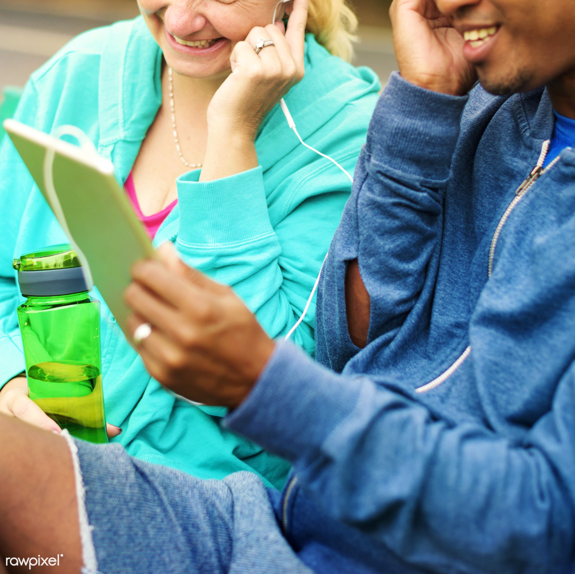 Couple listening to music from a tablet - cheerful, clothing, communication, couple, device, digital, exercise, form, garden...