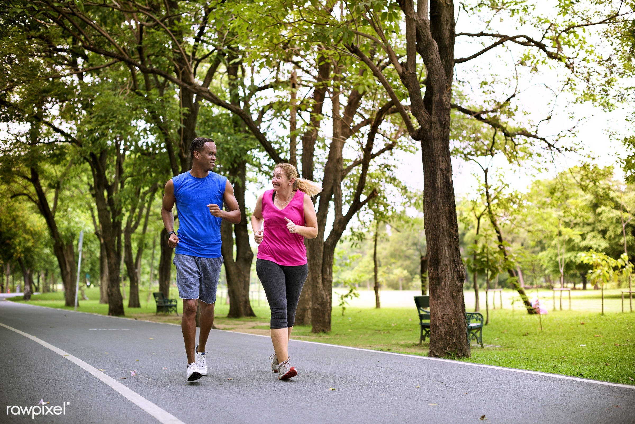 Mixed race couple exercising together in the park - adult, african, african descent, bonding, caucasian, cheerful, clothing...