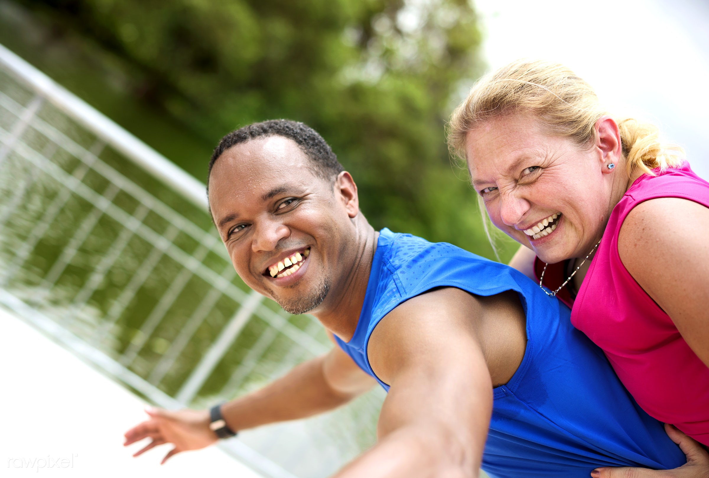 Interracial couple happy together in a park - adult, african, african descent, bonding, cheerful, clothing, couple, exercise...