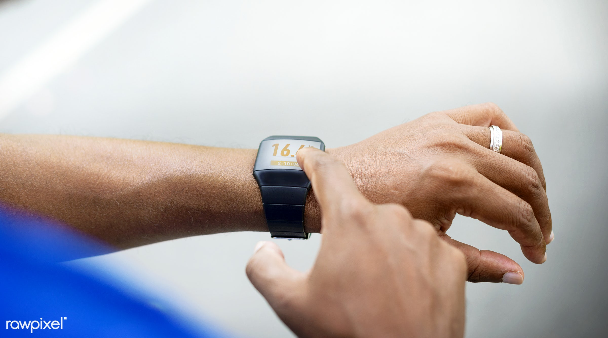 Man checking his fitness tracker - wellness, fitness, jogging, running, smart watch, watch, activity tracker, adult, african...