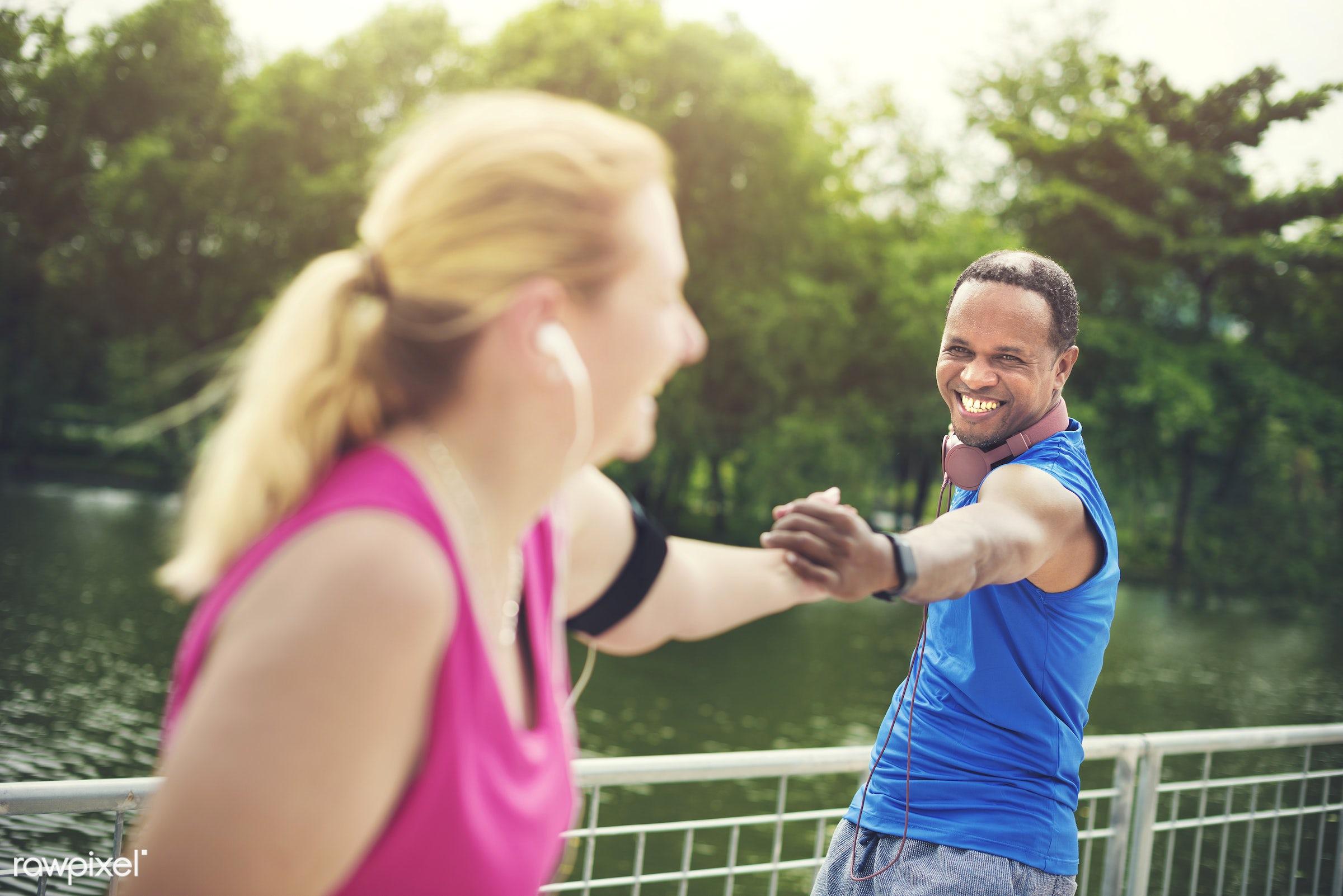 african, african descent, bonding, caucasian, cheerful, clothing, couple, earphone, exercise, fitness, form, garden, green,...