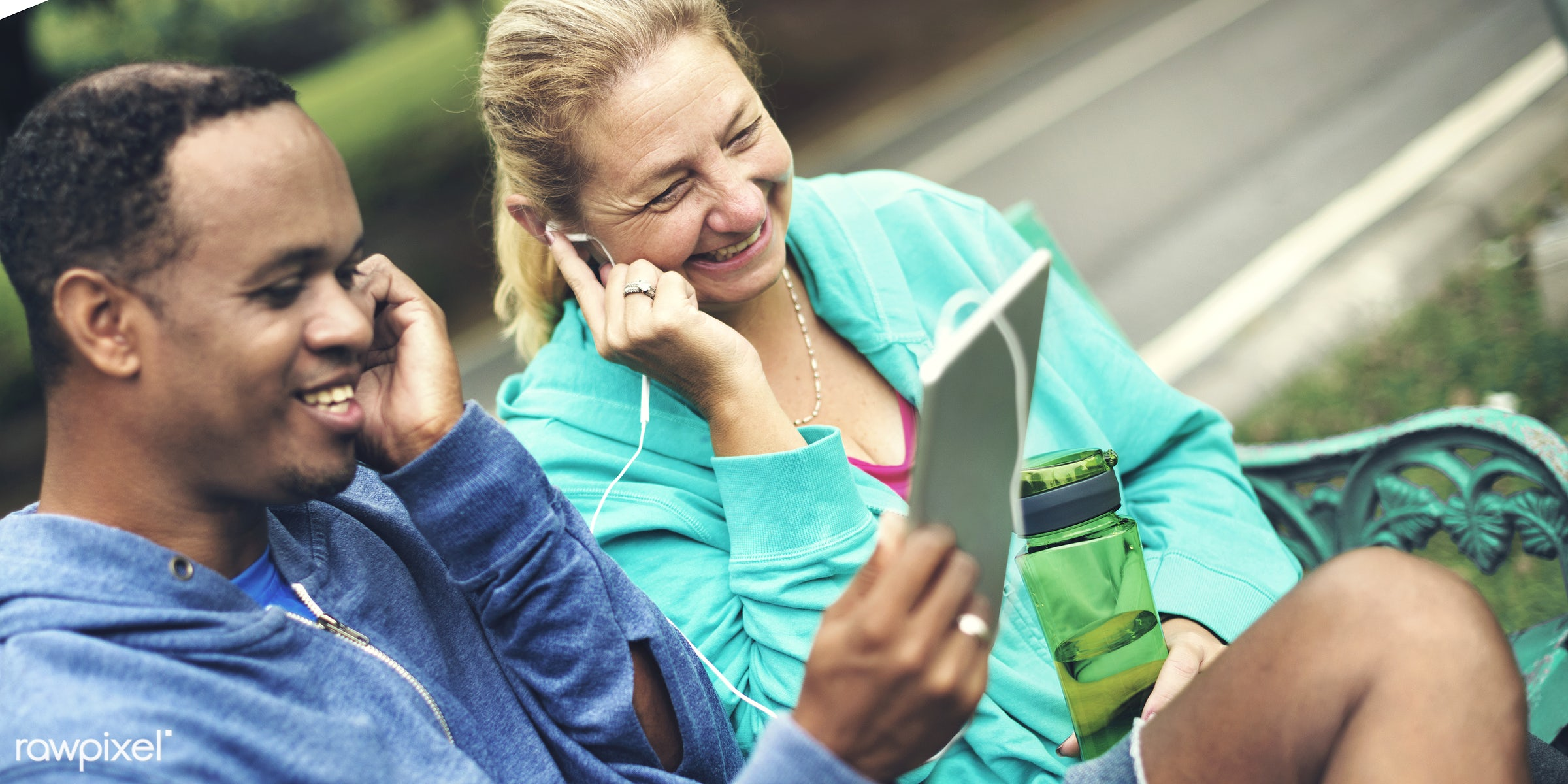 african, african descent, caucasian, cheerful, clothing, communication, couple, device, digital, exercise, form, garden,...