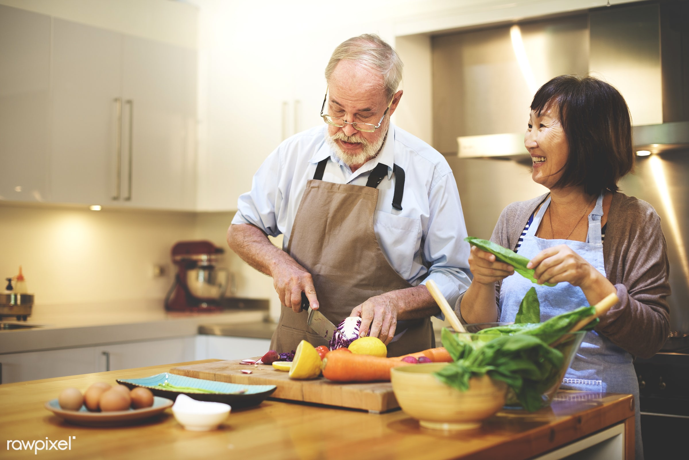 Senior couple cooking in the kitchen - activity, asian ethnicity, bonding, casual, cheerful, chef, communication, connection...