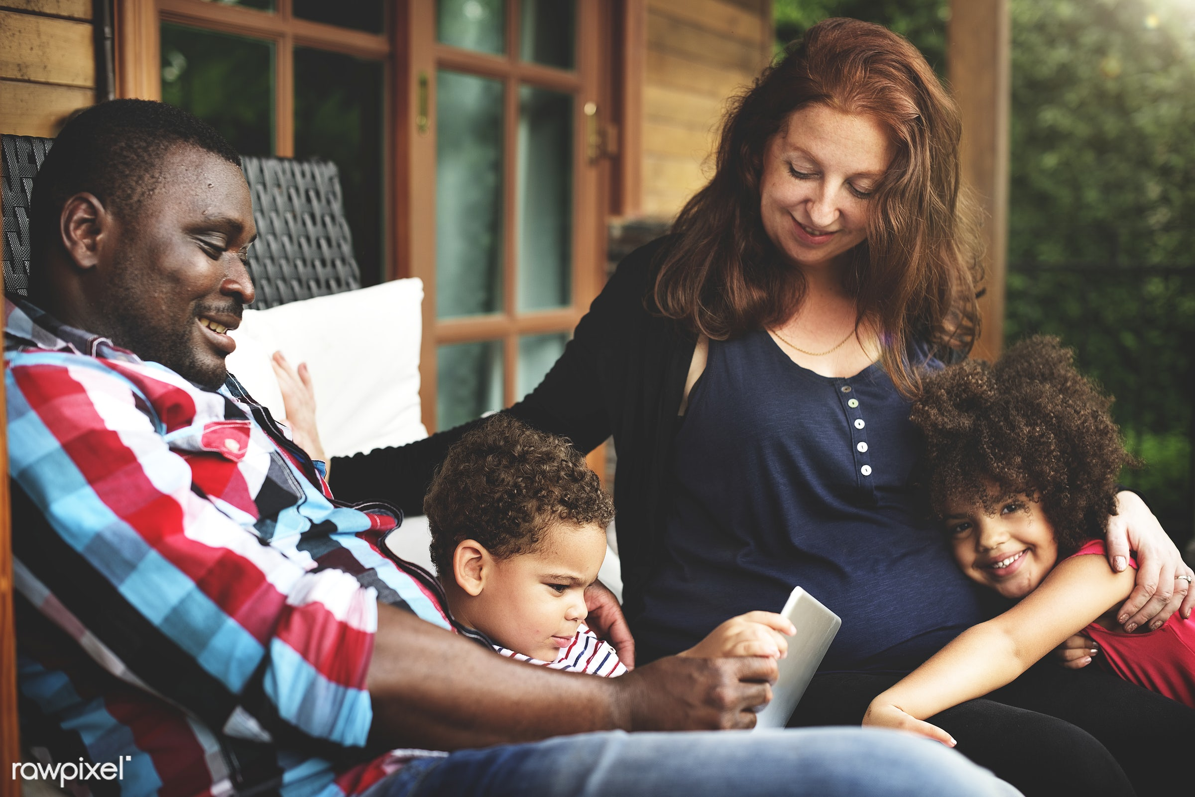 Mixed race family having fun together - tablet, african american, connecting, family, activity, african, african descent,...