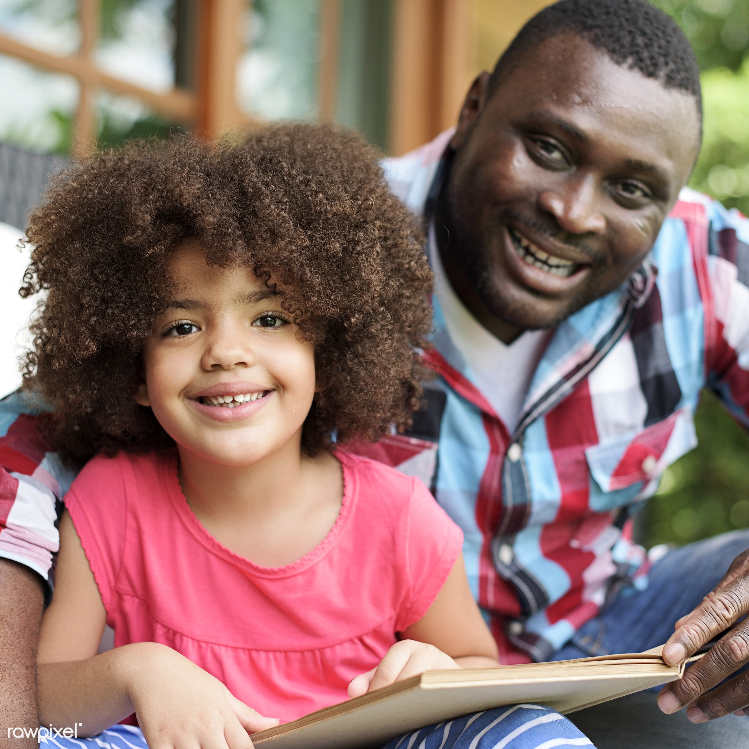 Father and daughter reading a book - child, activity, african, african american, african descent, black, bonding, book,...