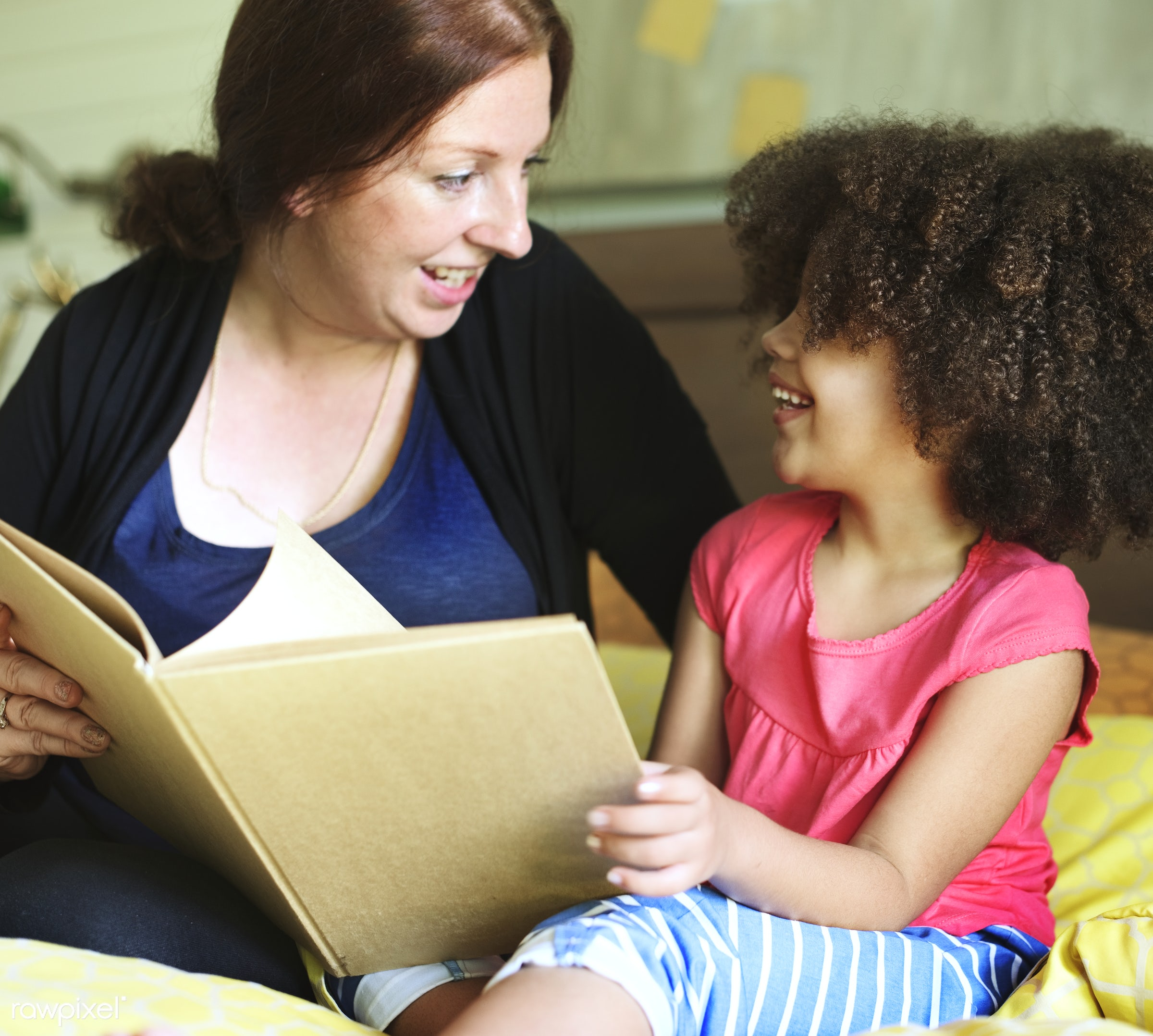 Mother reading to her daughter - activity, african, african american, african descent, bedroom, bonding, book, carefree,...