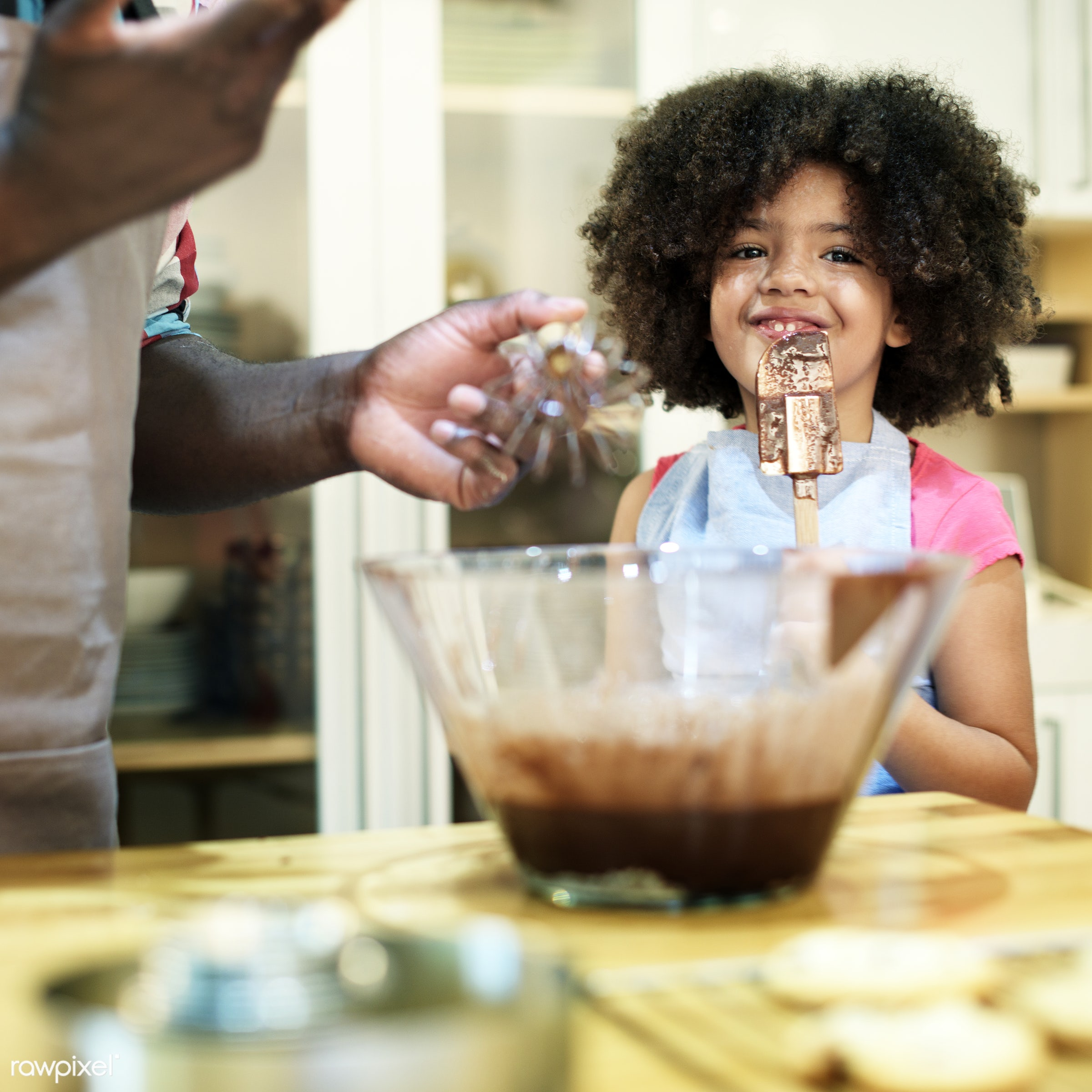 Father and daughter baking in the kitchen - activity, african, african american, african descent, bakery, baking, black,...