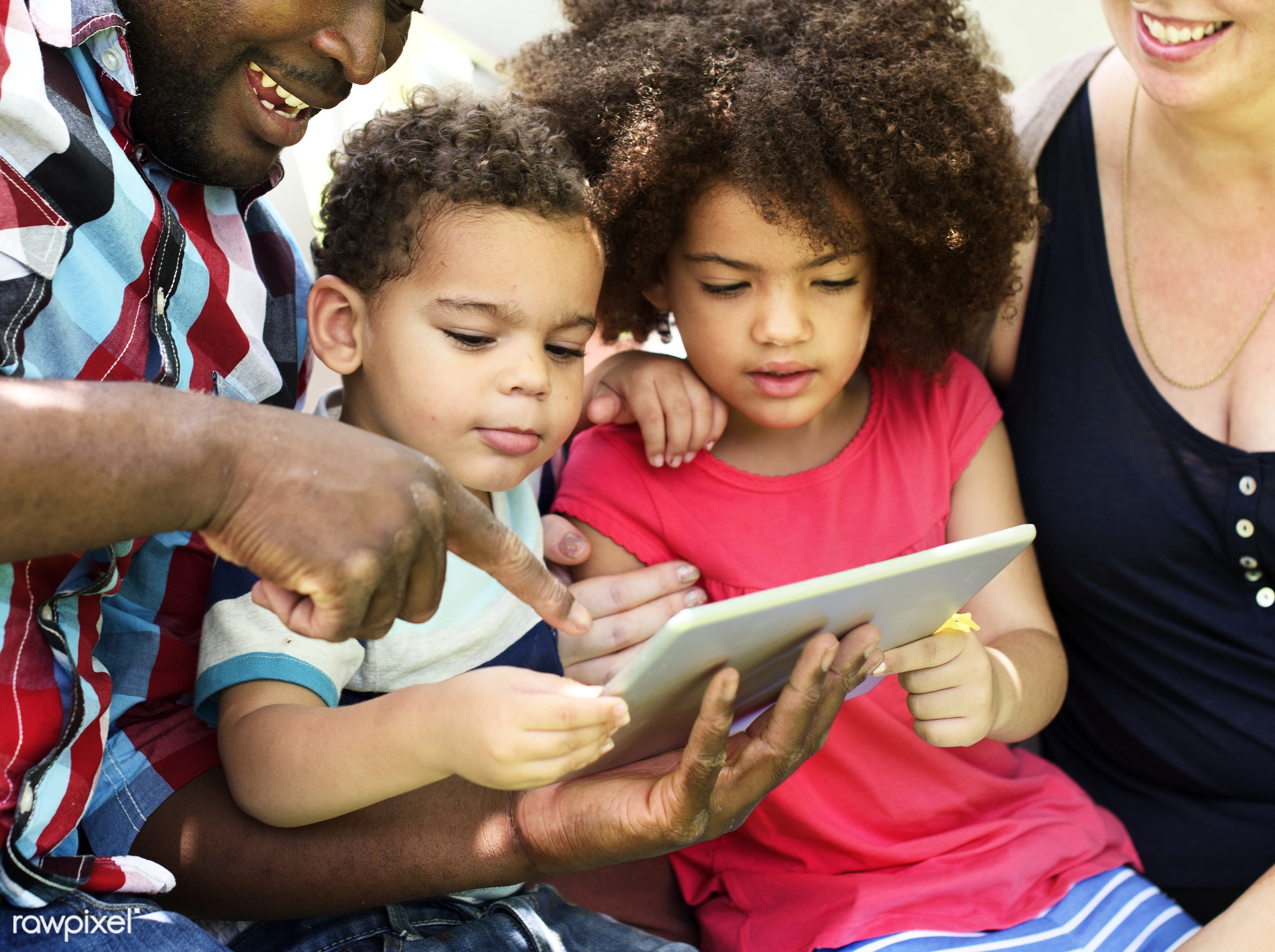 Family using a tablet together - activity, african, african american, african descent, black, bonding, brother, carefree,...