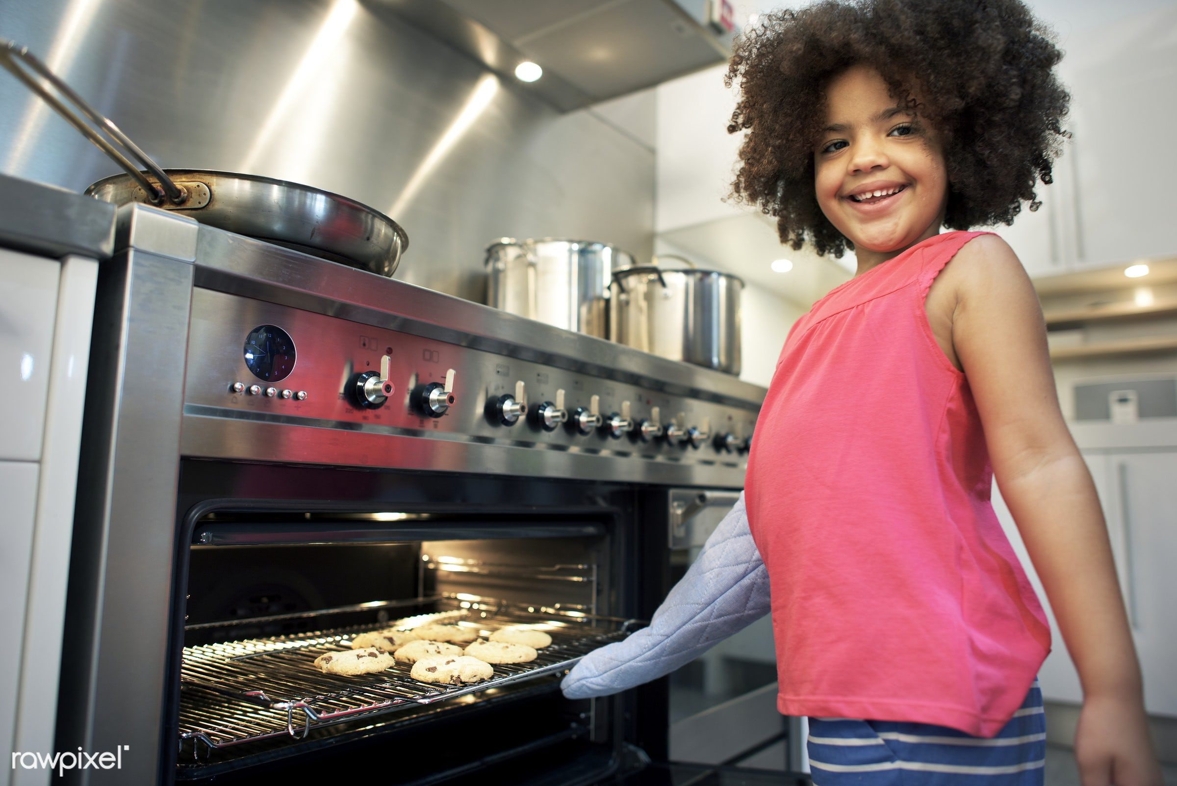 Little girl making cookies - cooking, activity, african, african american, african descent, bake, baker, bakery, baking,...