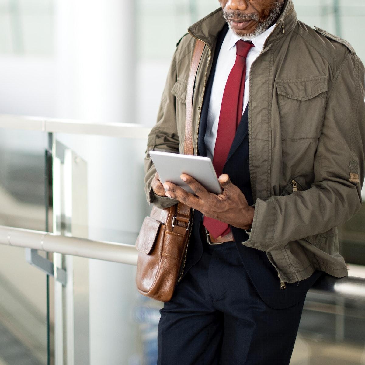 Businessman is using digital tablet