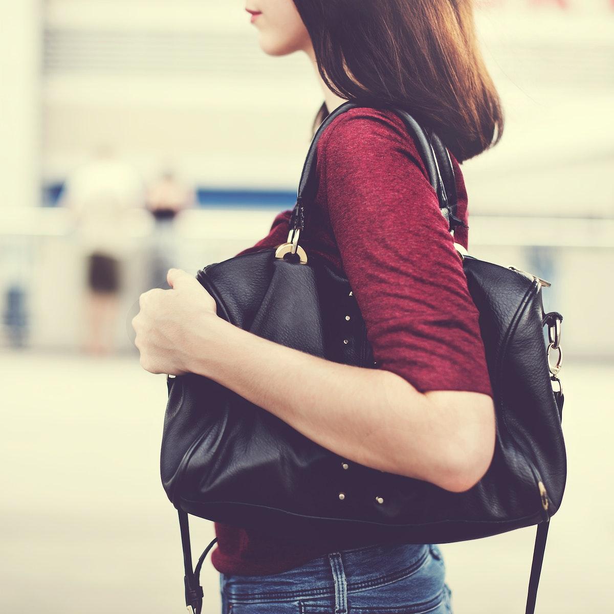 Closeup of woman with shoulder bag