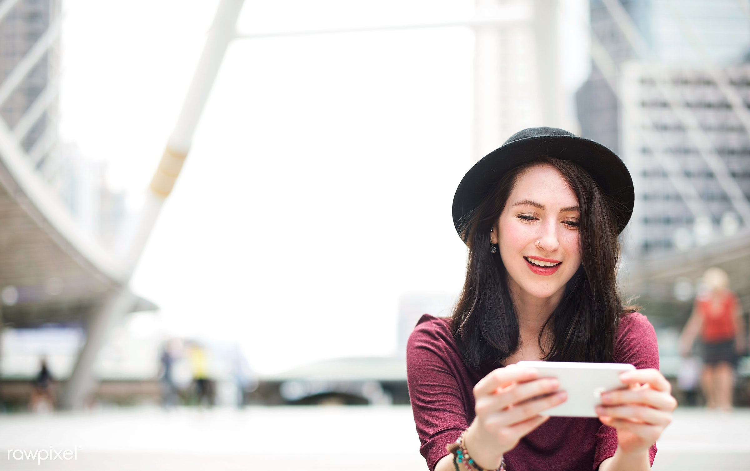 Young woman playing on her phone - phone, smartphone, texting, attractive, beautiful, brown hair, communication, connecting...