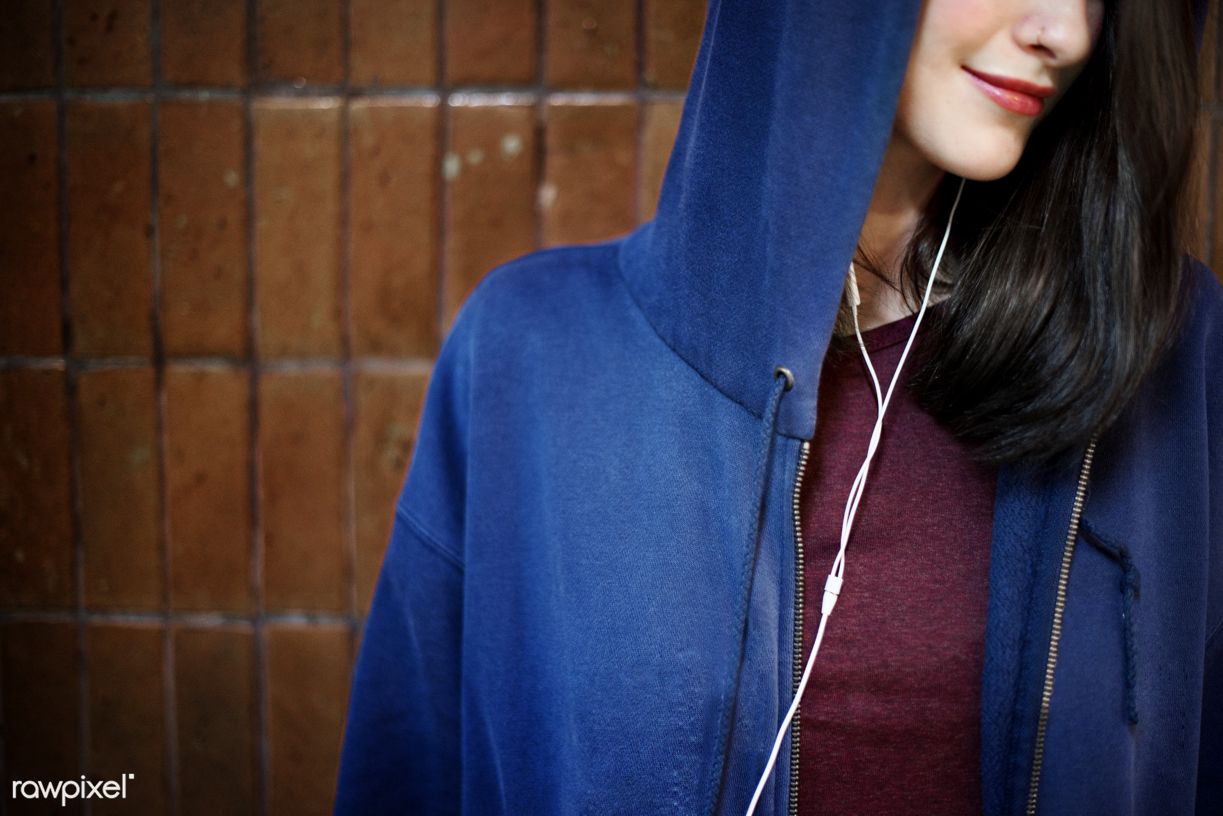 Young woman wearing a hoody - audio equipment, beautiful, calm, casual, cheerful, chilling, connection, content, device,...