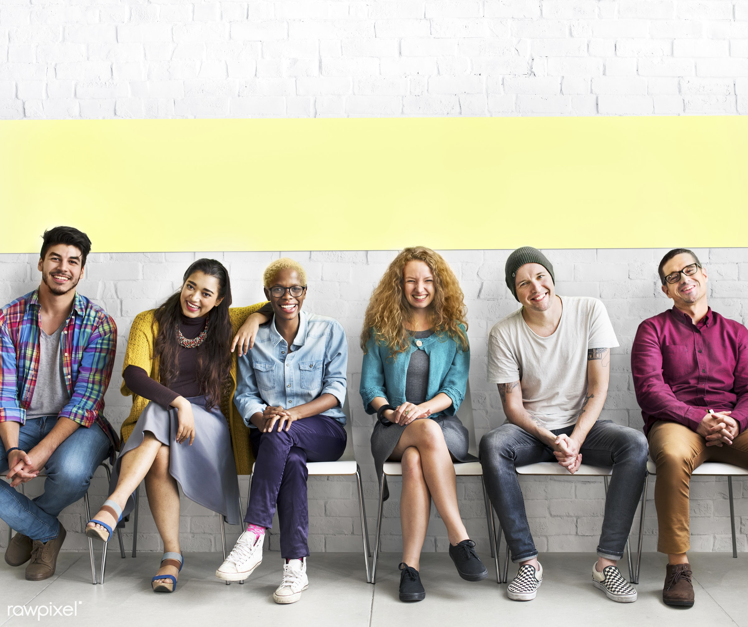 Diverse friends sitting in a row - adult, african descent, boys, brick wall, casual, chairs, cheerful, closeness, colleagues...