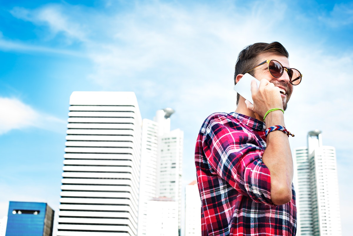 Young Man Outdoors Talking Smartphone Concept