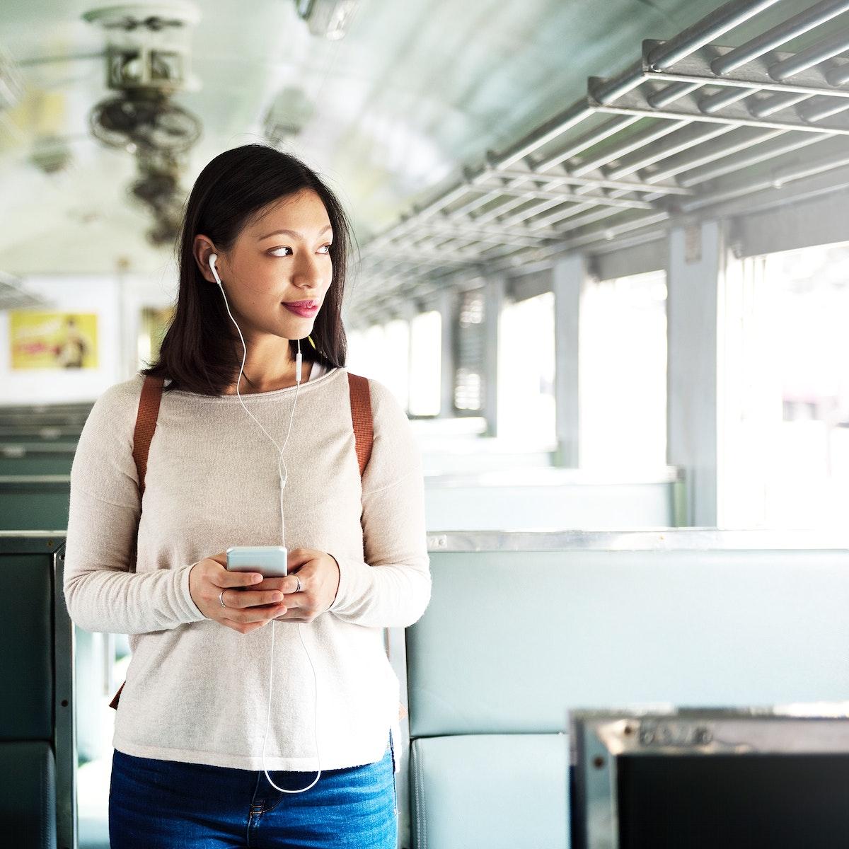 Asian woman riding a train