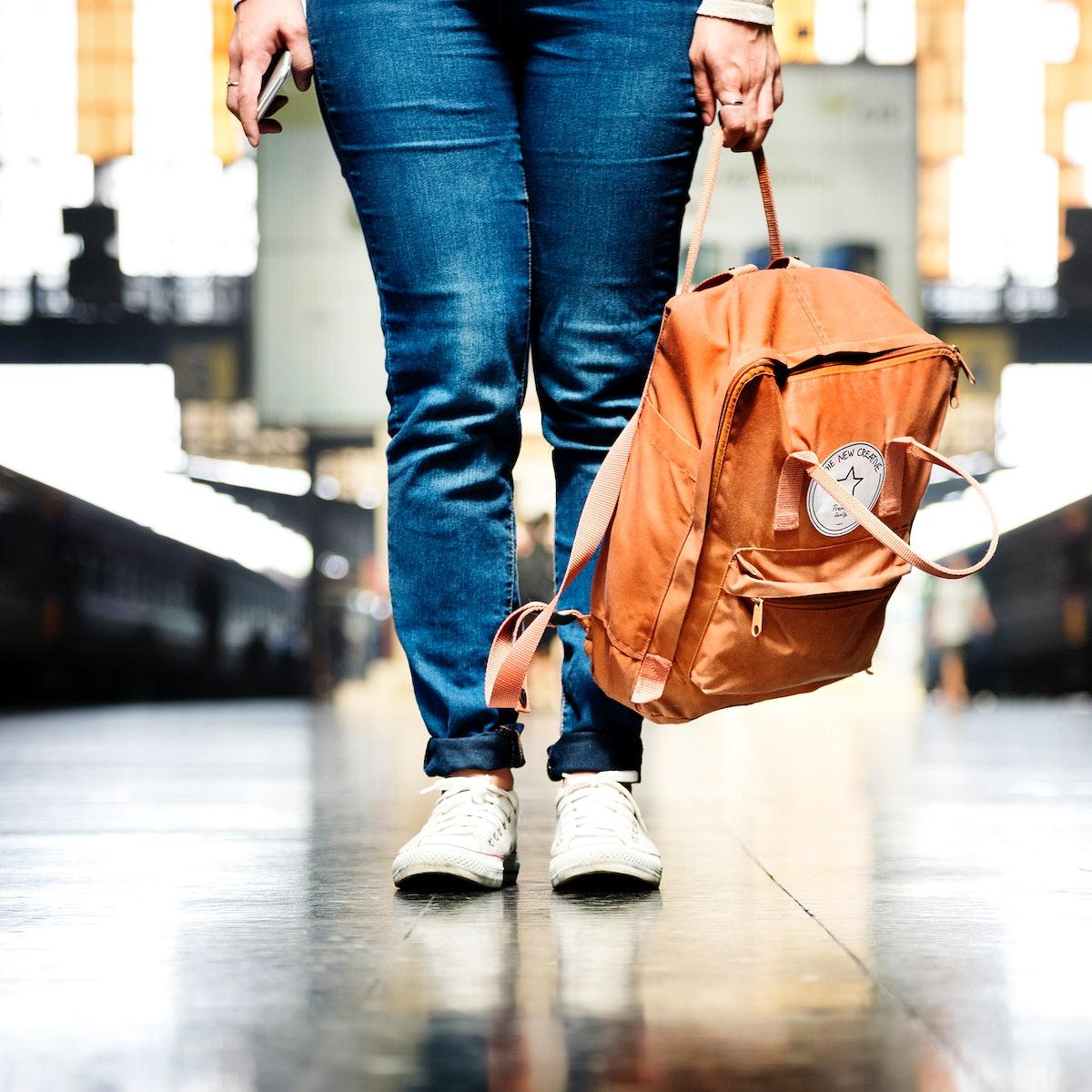 Asian woman carrying a bag