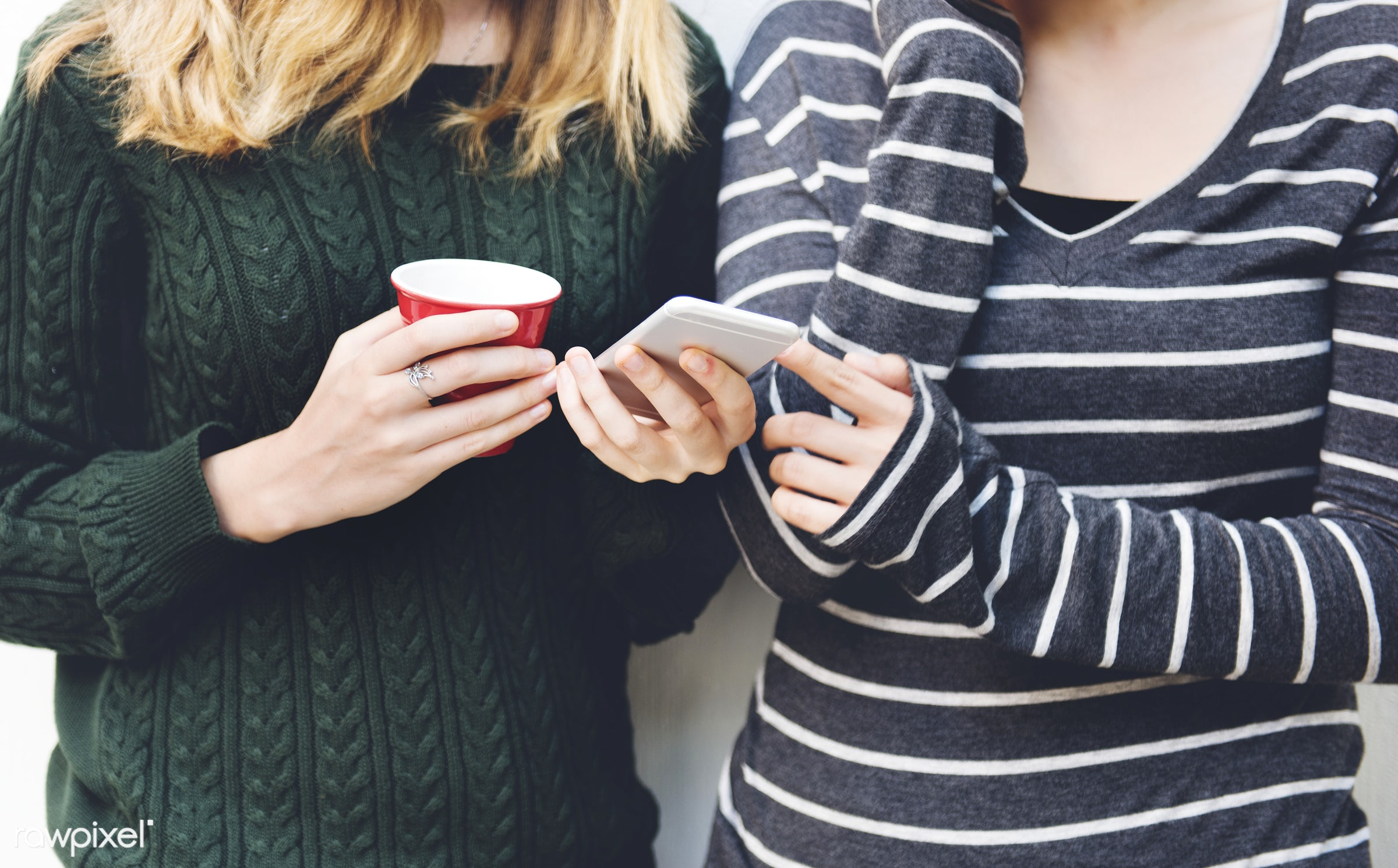 Young women are using mobile phone - asian, caucasian, coffee, communication, connection, conversation, cup, device, digital...