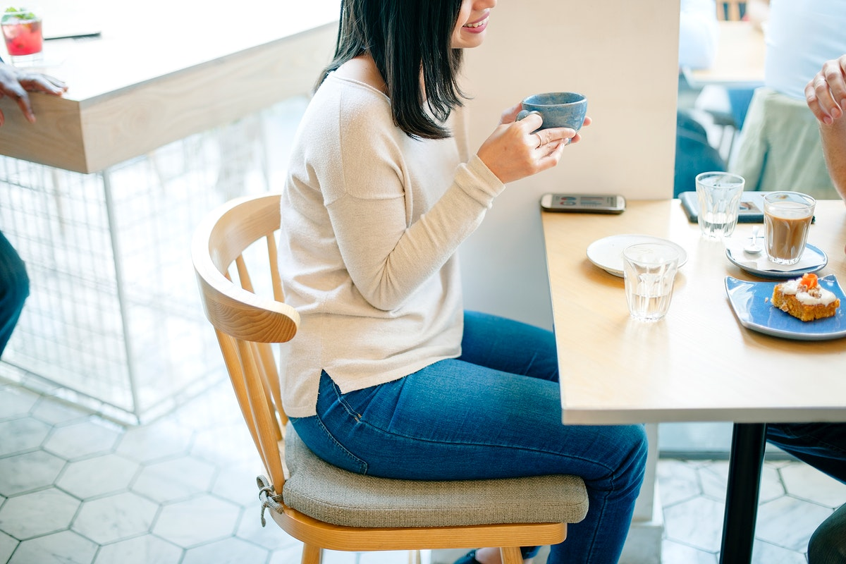 Asian woman sitting in coffee cafe