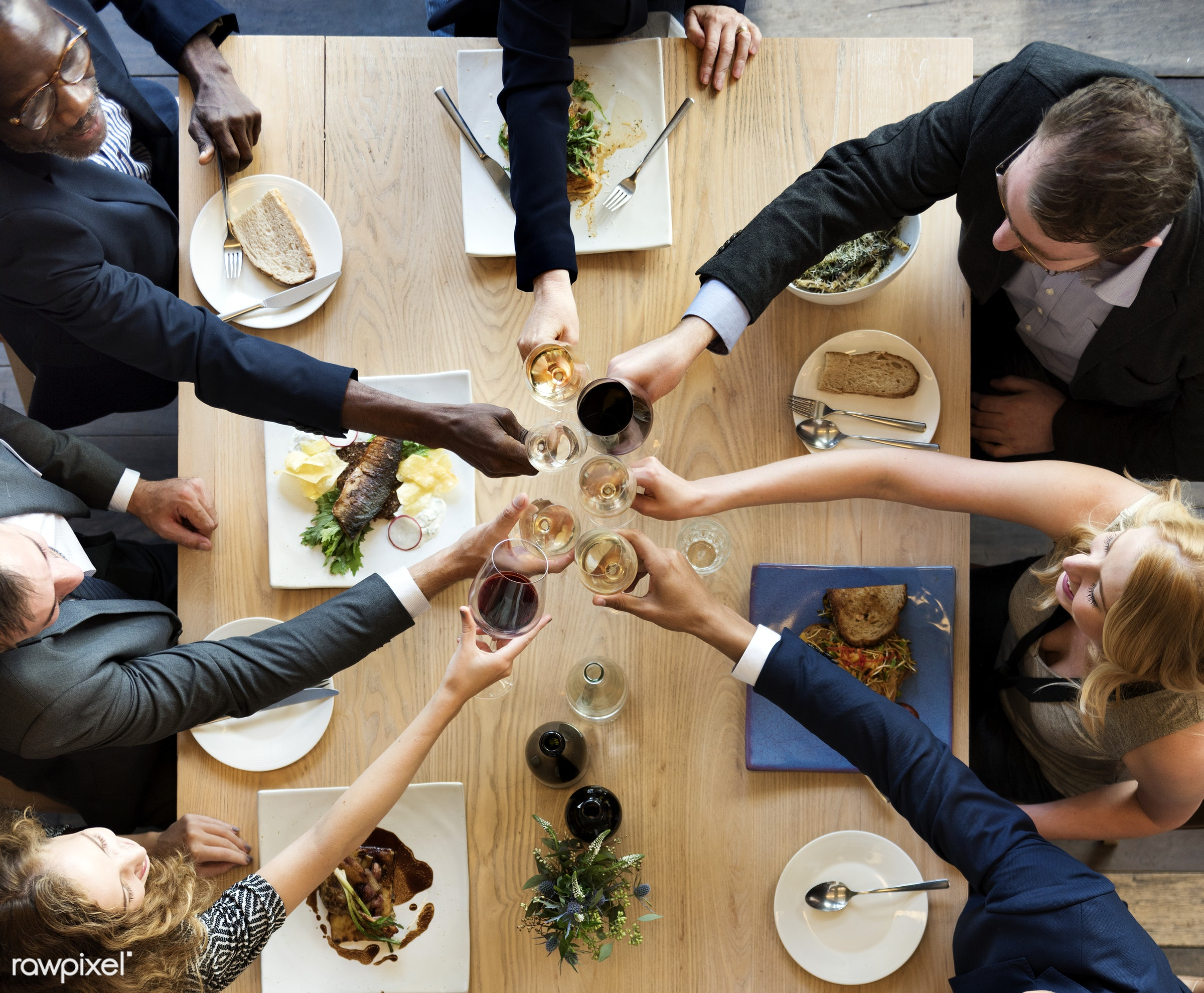 Group of diverse people are having lunch together - restaurant, food, happiness, toast, african american, african descent,...