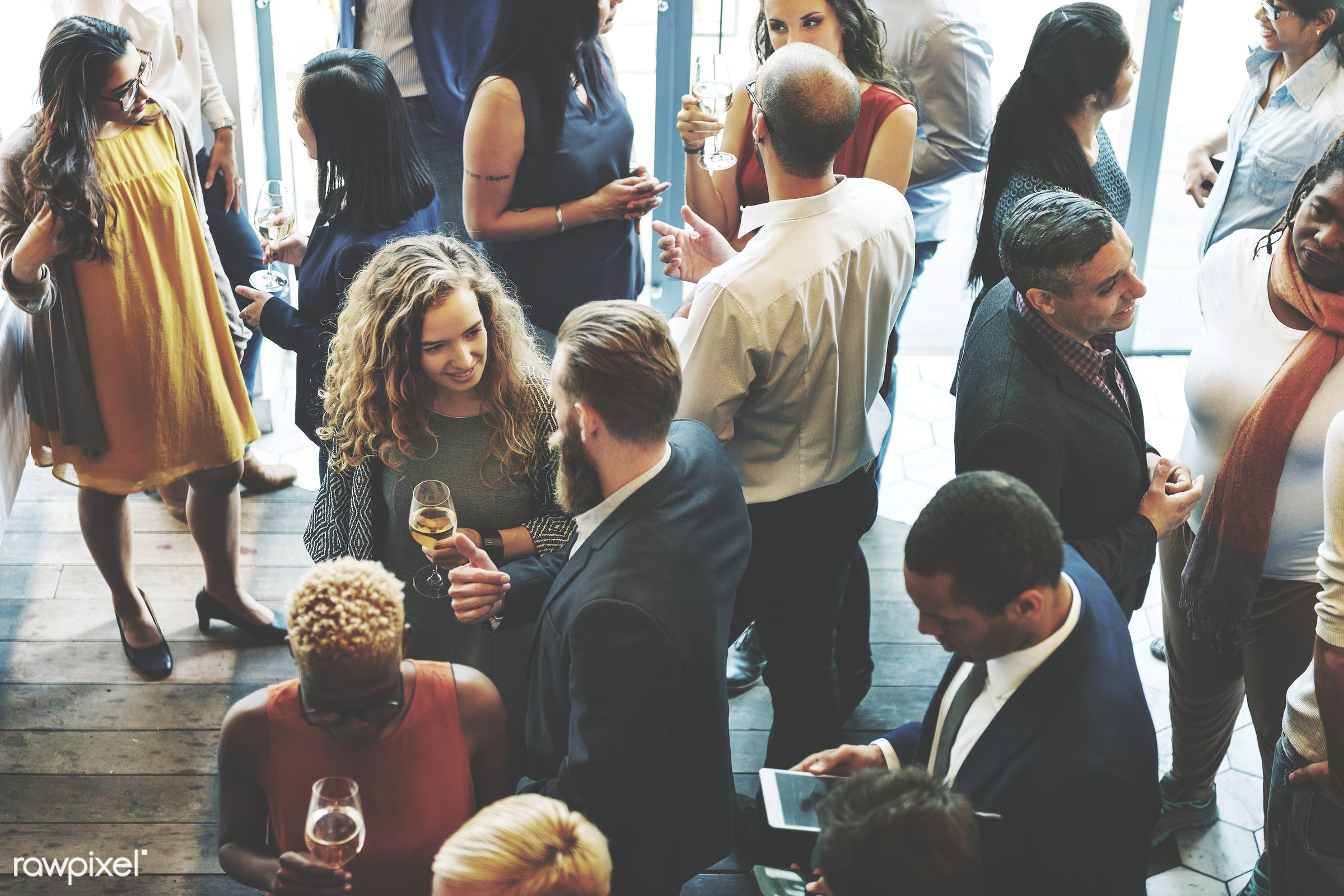 Diverse group of business people having a meetup - network, networking, talking, meeting, group, party, african american,...