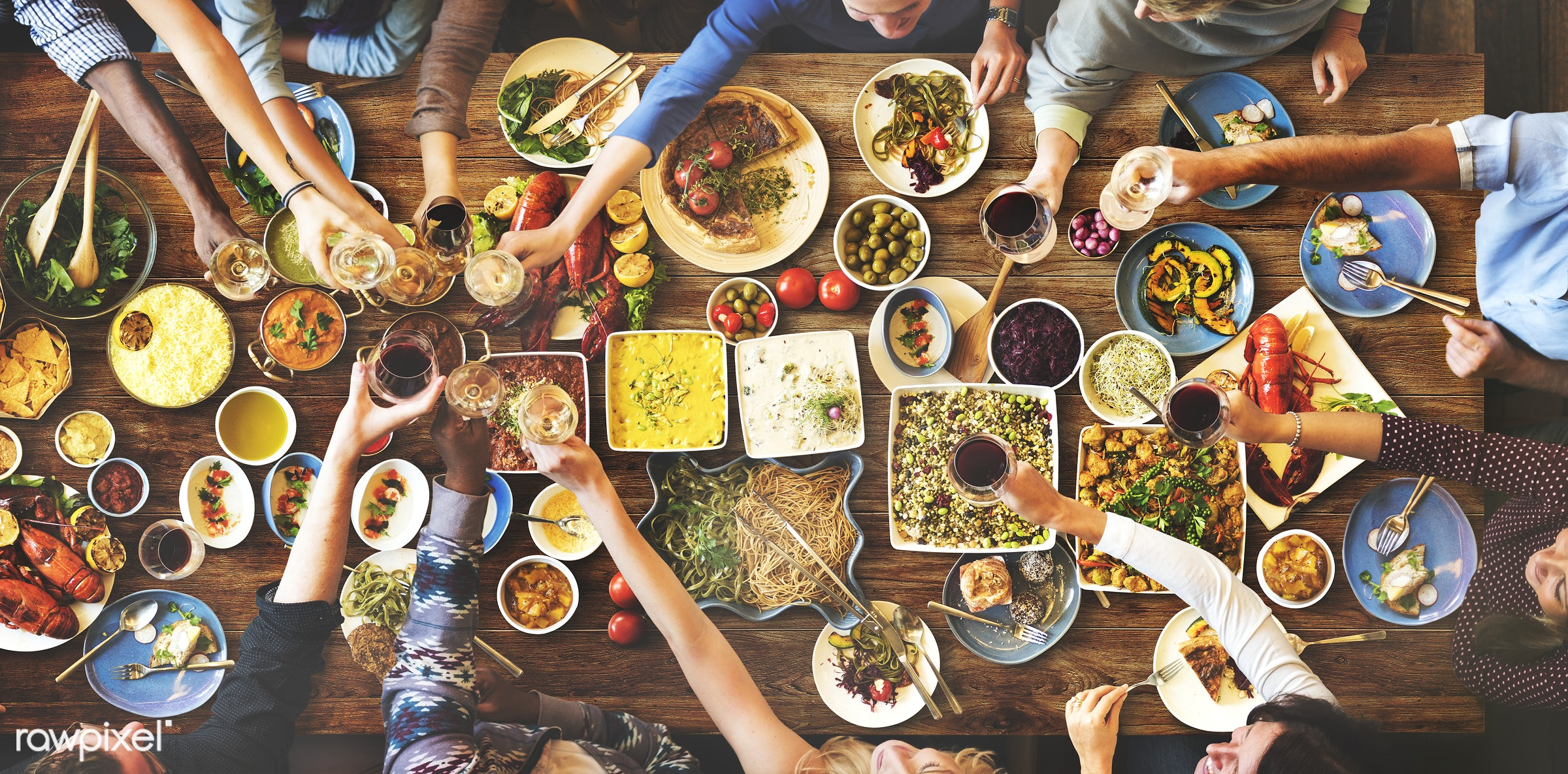 Group of diverse people are having lunch together - food, restaurant, cuisine, lunch, african american, african descent,...