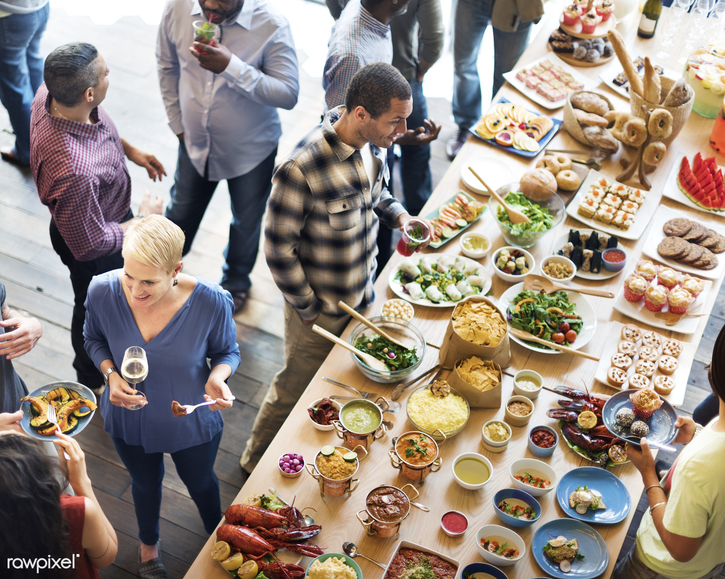 Group of diverse people are having lunch together - african american, african descent, asian, black, caucasian, cheerful,...
