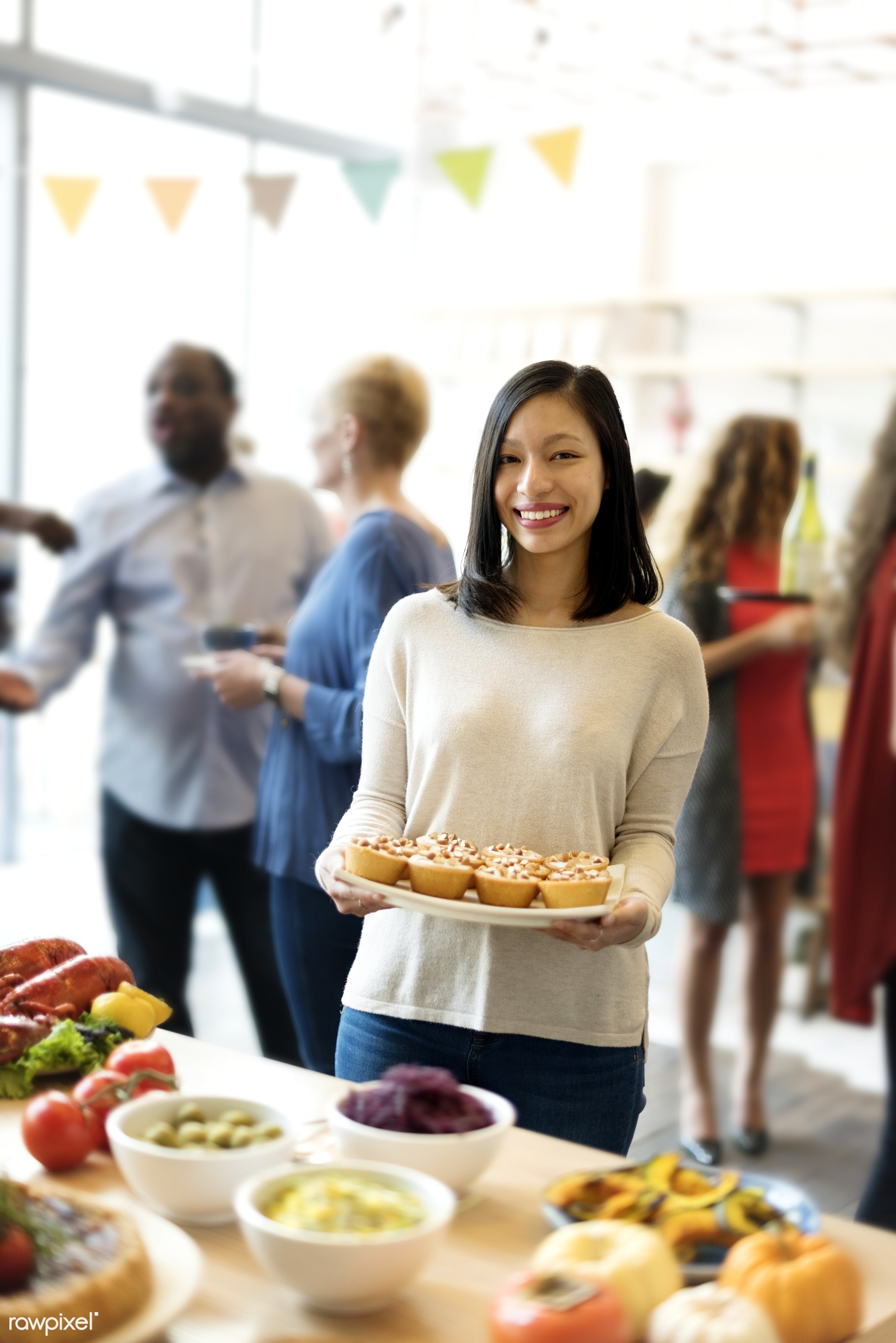 Woman is holding a dish of pastry - asian, baked, catering, cheerful, closeup, dessert, food, hands, happiness, holding,...