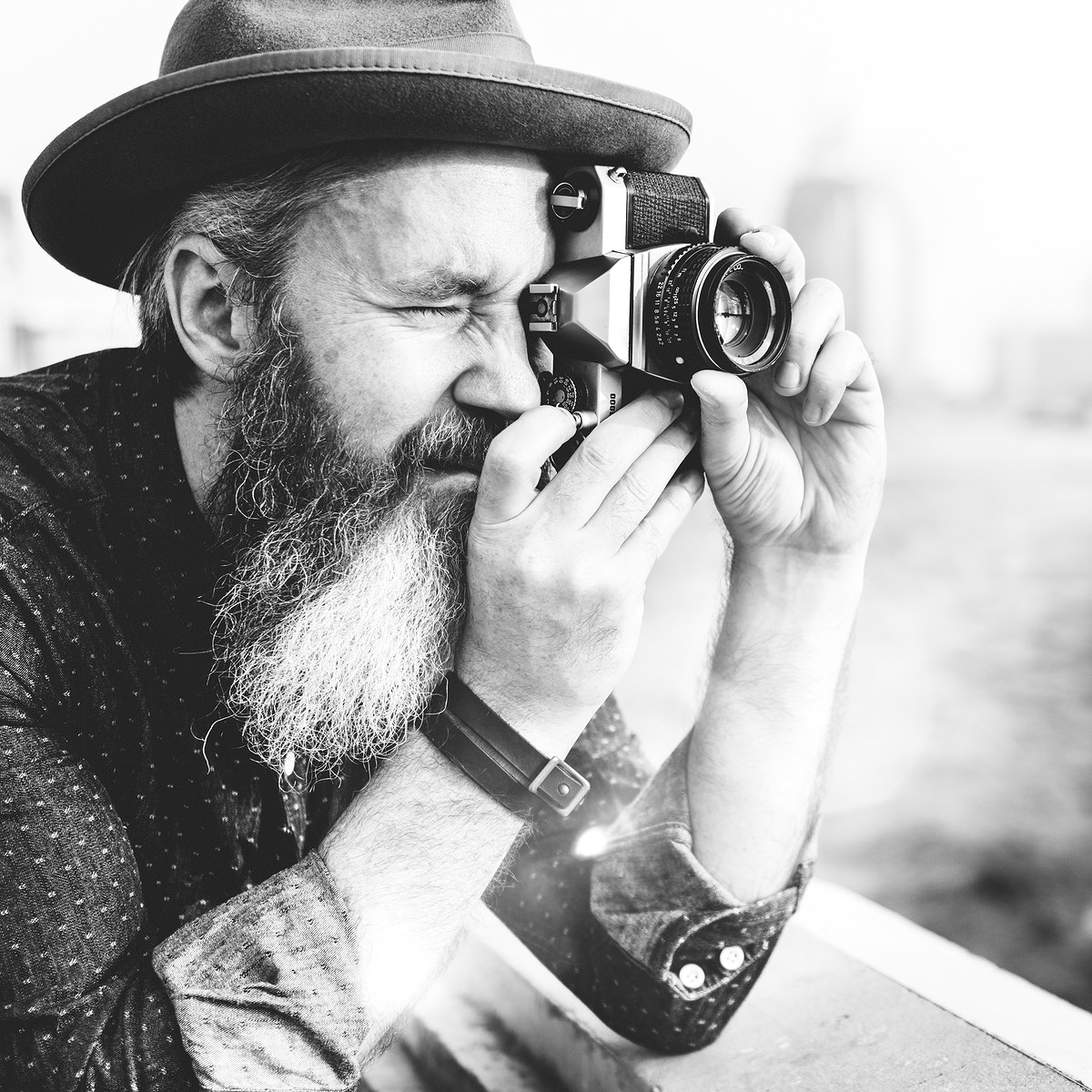 A photographer with an analog camera